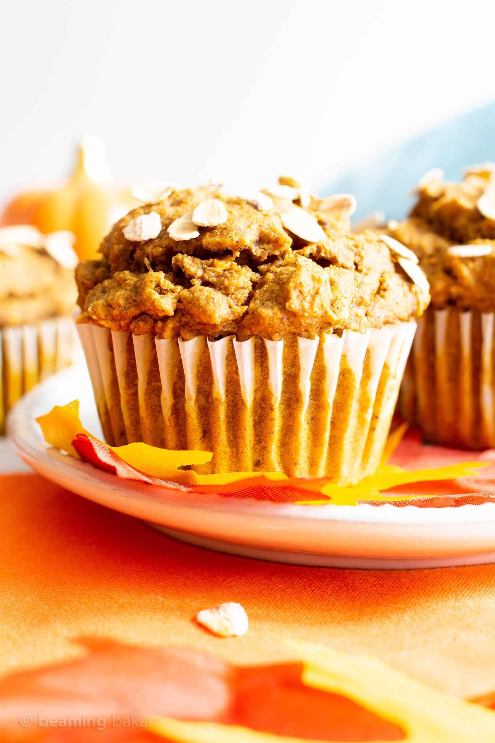 This Healthy Pumpkin Oatmeal Muffins recipe yields lightly sweet, moist pumpkin oatmeal muffins made with vegan + gluten free ingredients. #Pumpkin #Oatmeal #Muffins | Recipe at BeamingBaker.com