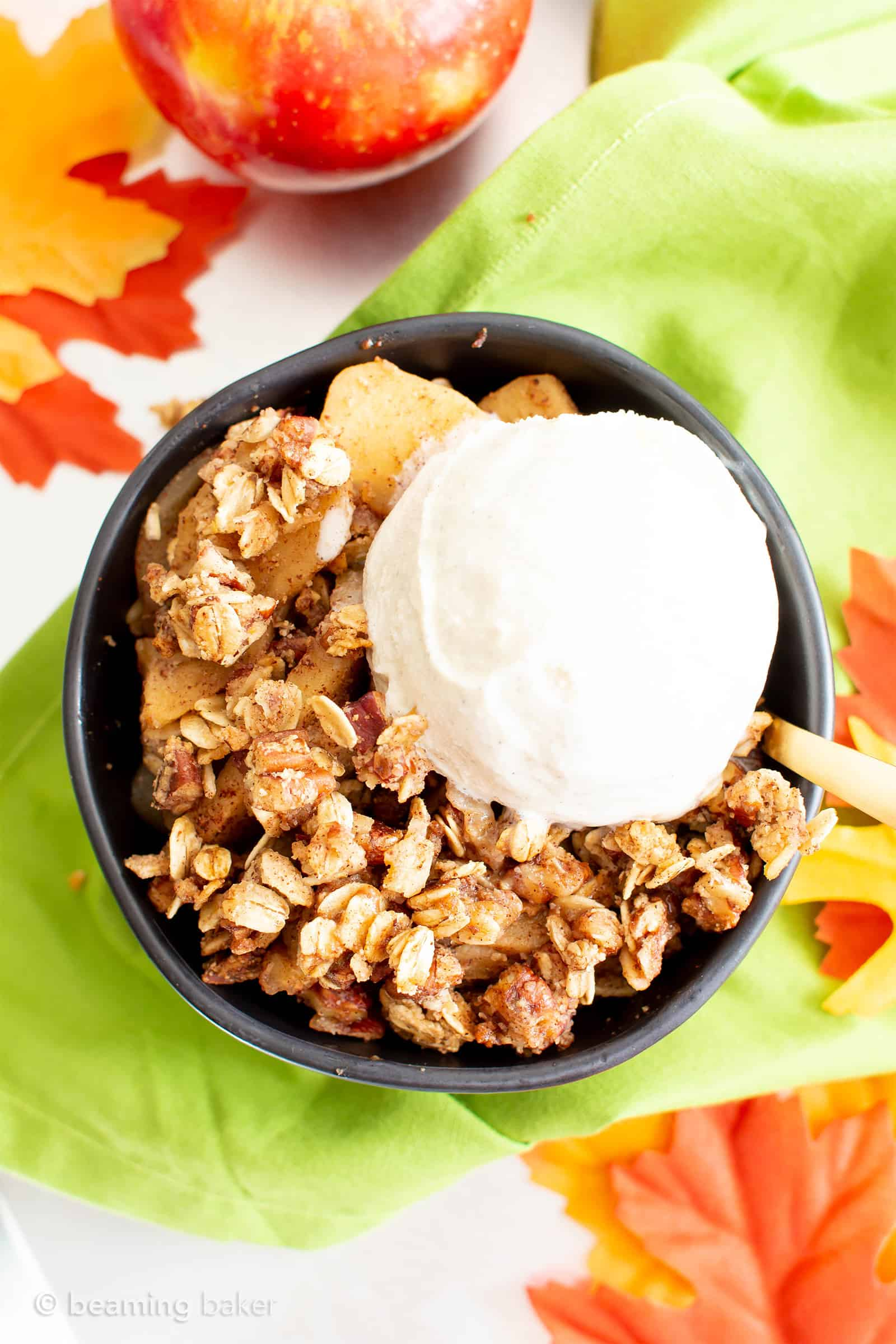 Vegan Gluten Free Cinnamon Apple Crisp with Oats (V, GF): an easy recipe for a warm, gooey apple crisp with delicious cinnamon oat topping. Made with healthy ingredients. #Vegan #GlutenFree #GlutenFreeVegan #AppleCrisp #HealthyDesserts #Fall | Recipe at BeamingBaker.com