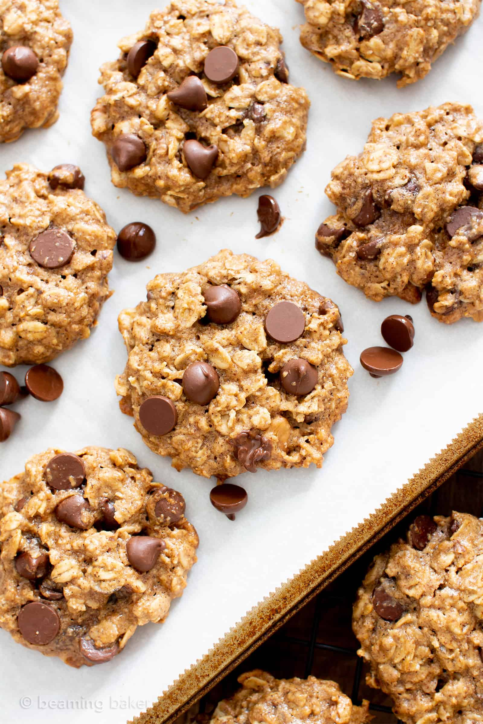 Easy Healthy Oatmeal Chocolate Chip Cookies: this easy healthy oatmeal chocolate chip cookies recipe yields chewy cookies with crispy edges and lots of chocolate chips! Vegan, Gluten-Free, Dairy-Free, Healthy. #Healthy #OatmealCookies #HealthyCookies #ChocolateChip | Recipe at BeamingBaker.com