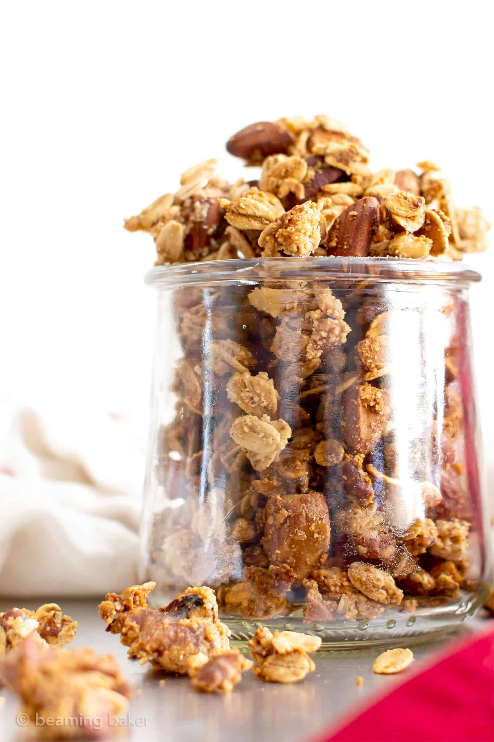 Gluten Free Chai Spice Granola Recipe (V, GF): a super easy, 1-bowl recipe for crunchy granola bursting with your favorite fall spices and nuts! Made with healthy ingredients. #Vegan #BeamingBaker #GlutenFree #VeganGlutenFree #Granola #HomemadeGranola #ChaiSpice #HealthySnacks | Recipe at BeamingBaker.com