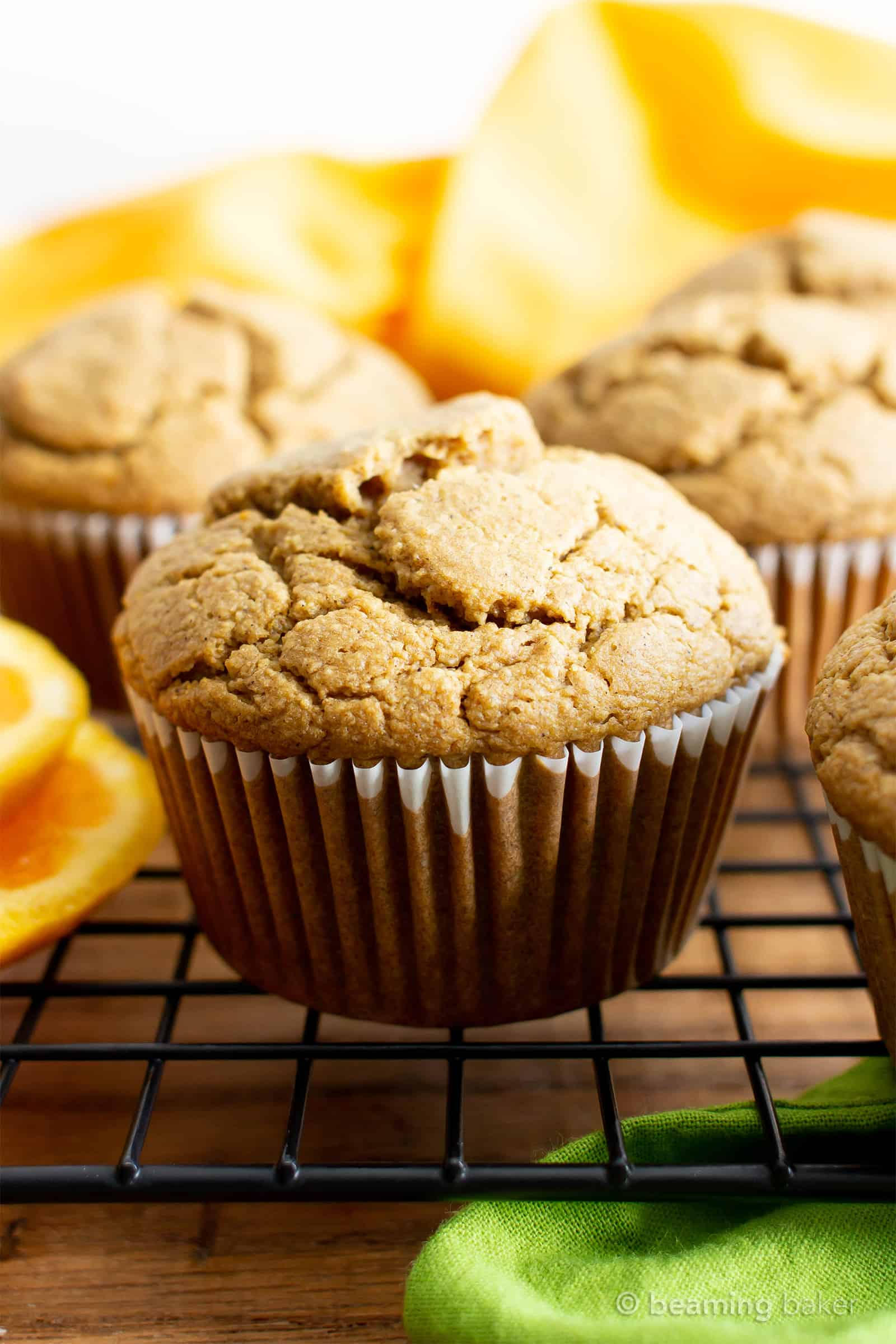 Healthy Gluten Free Orange Cardamom Muffins Recipe (V, GF): an easy, 1-bowl recipe for soft, fluffy orange muffins with a hint of delicious cardamom flavor. Made with healthy ingredients. #Vegan #GlutenFree #DairyFree #HealthyMuffins #GlutenFreeVegan #BeamingBaker | Recipe at BeamingBaker.com