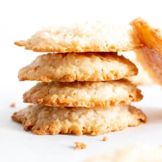 4 Ingredient Vegan Coconut Cookies: chewy, crispy healthy coconut cookies bursting with coconut flavor. The best gluten free coconut cookies—paleo ingredients, delicious! #Vegan #Cookies #Paleo #Healthy #Coconut | Recipe at BeamingBaker.com
