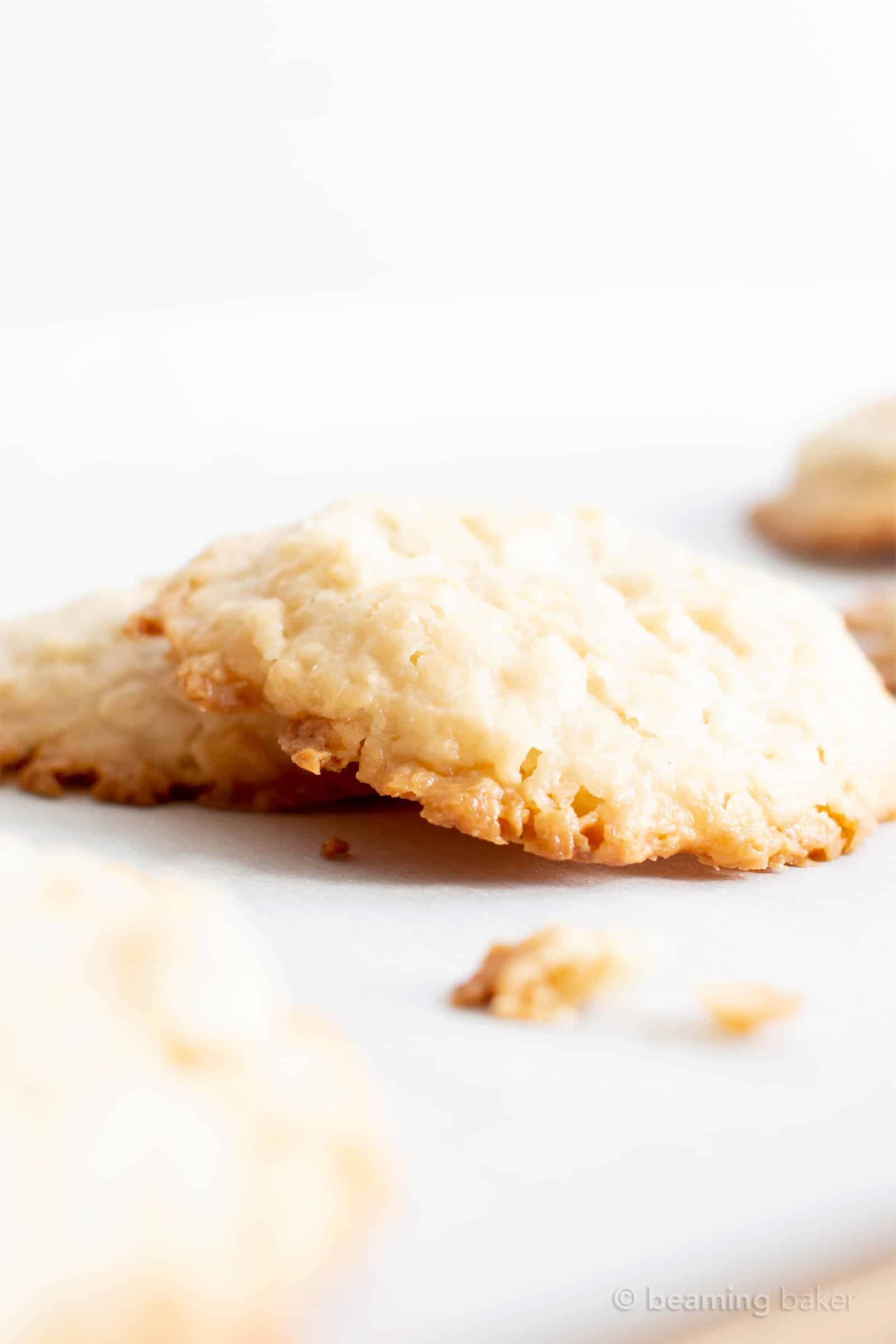 Ultimate Chewy Paleo Coconut Cookies (V, GF): the best coconut cookies! Moist and chewy on the inside, with delicious crispy edges, bursting with amazing coconut flavor. Made with healthy ingredients. #Paleo #Vegan #GlutenFree #DairyFree #BeamingBaker #Coconut #Cookies | Recipe at BeamingBaker.com