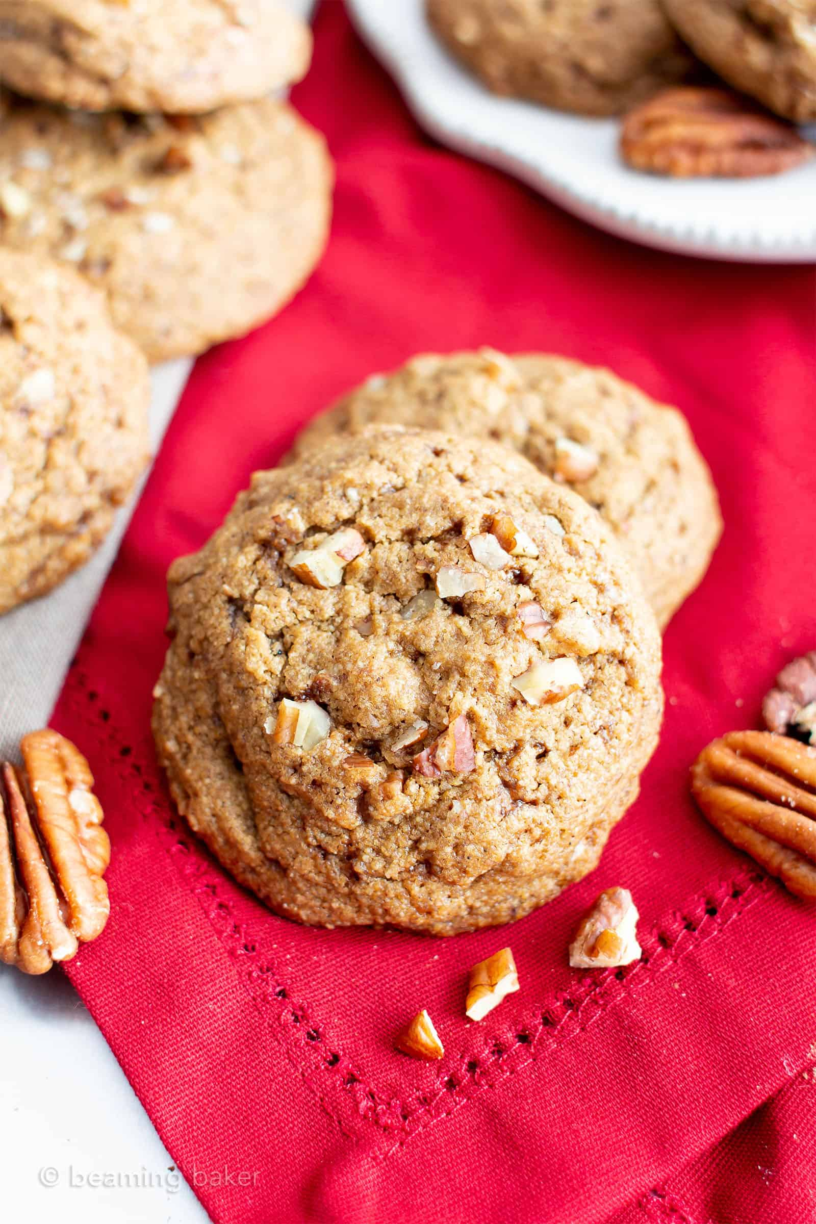 Easy Vegan Cinnamon Pecan Cookies (V, GF): an easy recipe for chewy on the outside, soft on the inside buttery gluten free pecan cookies bursting with pecan crunch and a cinnamon kick! Made with healthy ingredients. #Cookies #BeamingBaker #Vegan #GlutenFree #GlutenFreeCookies #Christmas #HealthyBaking #VeganCookies | Recipe at BeamingBaker.com