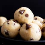 Paleo Cookie Dough Bites (V, GF): this decadent paleo edible cookie dough balls recipe is made with almond flour, just 6 healthy ingredients, easy & gluten-free! It's the best vegan chocolate chip cookie dough bites recipe ever! #CookieDough #Paleo #Vegan #Chocolate | Recipe at BeamingBaker.com