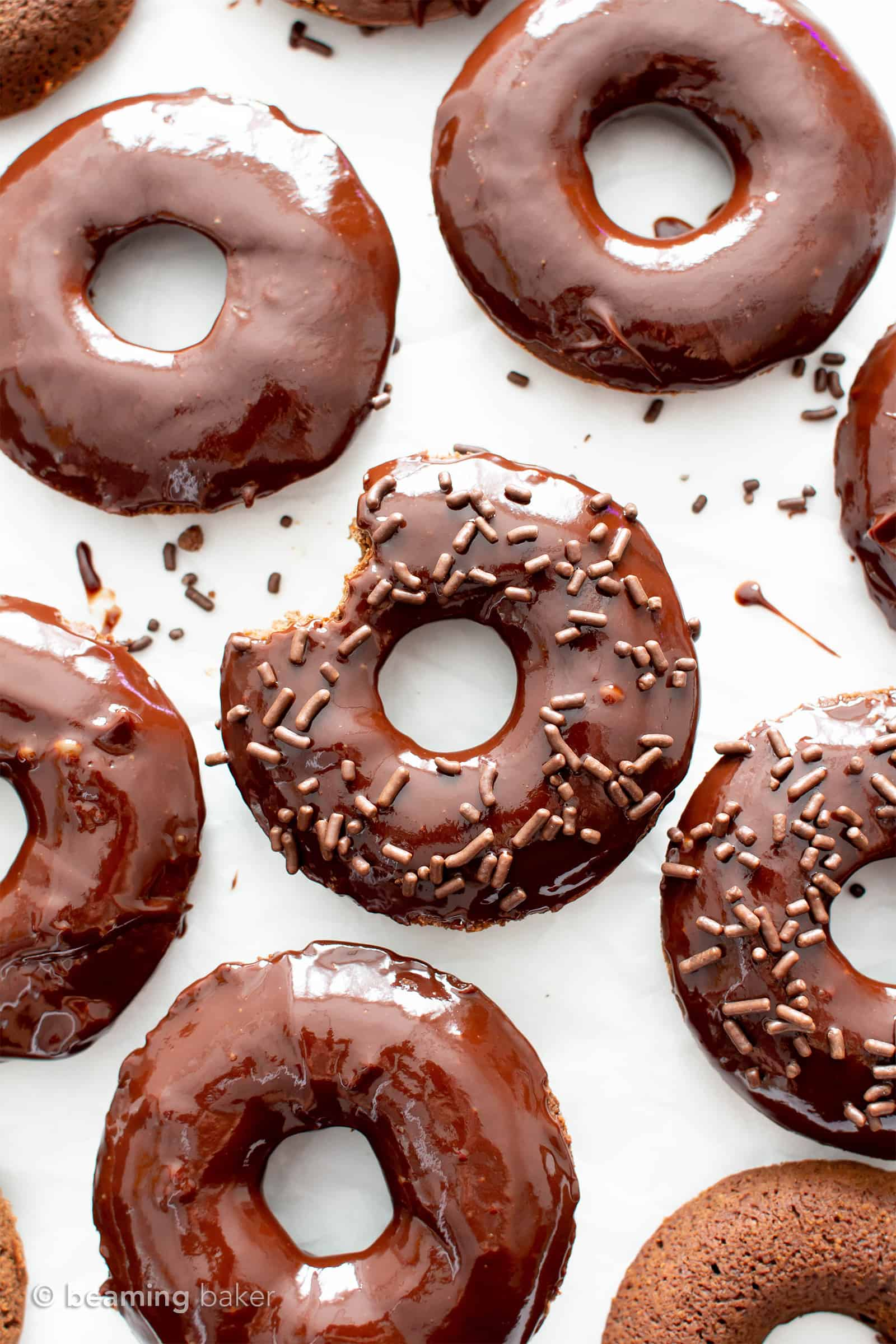 Soft Baked Chocolate Vegan Donuts Recipe (V, GF): this soft and fluffy vegan baked donut recipe is topped with luxurious vegan chocolate glaze. It's the best vegan gluten free chocolate donuts – easy, healthy and decadent! #Donuts #Vegan #GlutenFree #Chocolate | Recipe at BeamingBaker.com