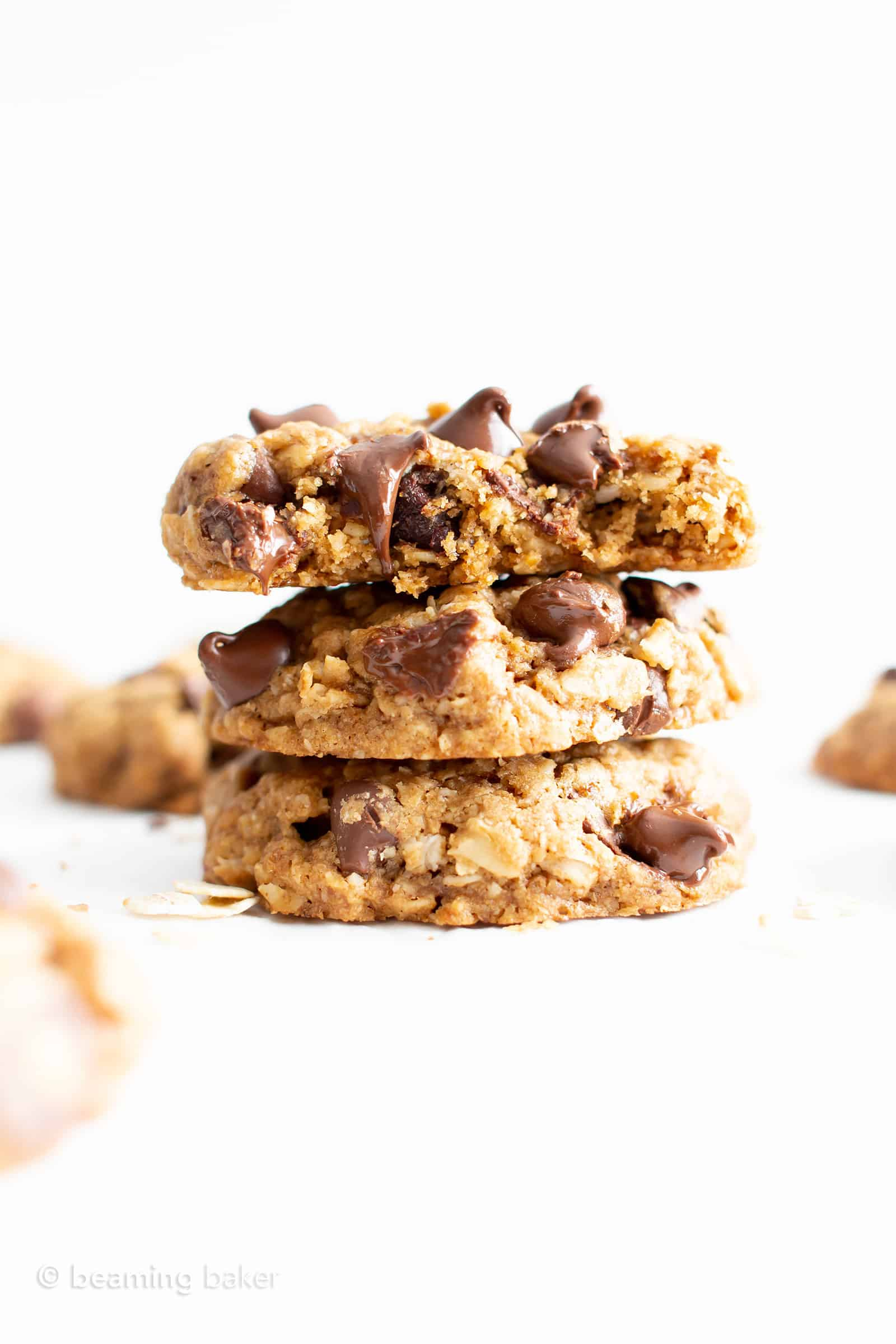 Best Gluten Free Oatmeal Chocolate Chip Cookies Recipe (GF, Vegan, Dairy-Free): this easy vegan oatmeal chocolate chip cookies recipe has a crispy exterior, soft & chewy interior, with cozy oatmeal flavor. It's the best GF oatmeal chocolate chip cookies – gluten free, dairy-free and made with healthy ingredients! #Vegan #GlutenFree #ChocolateChip #Cookies #DairyFree #Oatmeal | Recipe at BeamingBaker.com