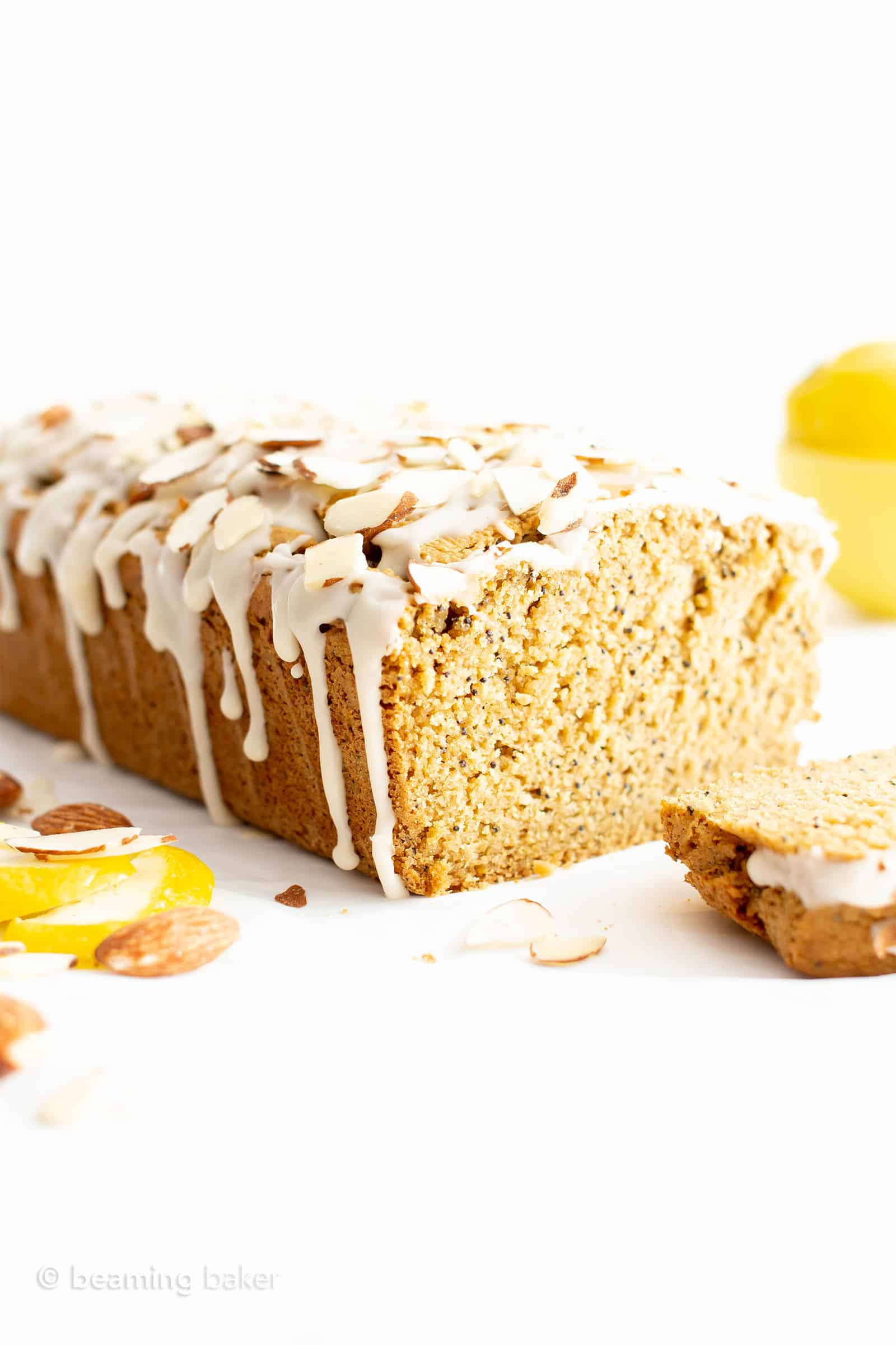 Easy Vegan Lemon Almond Poppy Seed Bread Recipe (Gluten-Free, Healthy): this easy gluten free lemon almond poppy seed bread recipe is moist, fluffy and bursting with lemon flavor! It's the best vegan lemon poppy seed bread – gluten-free, dairy-free, healthy! #Vegan #GlutenFree #DairyFree #Lemon | Recipe at BeamingBaker.com