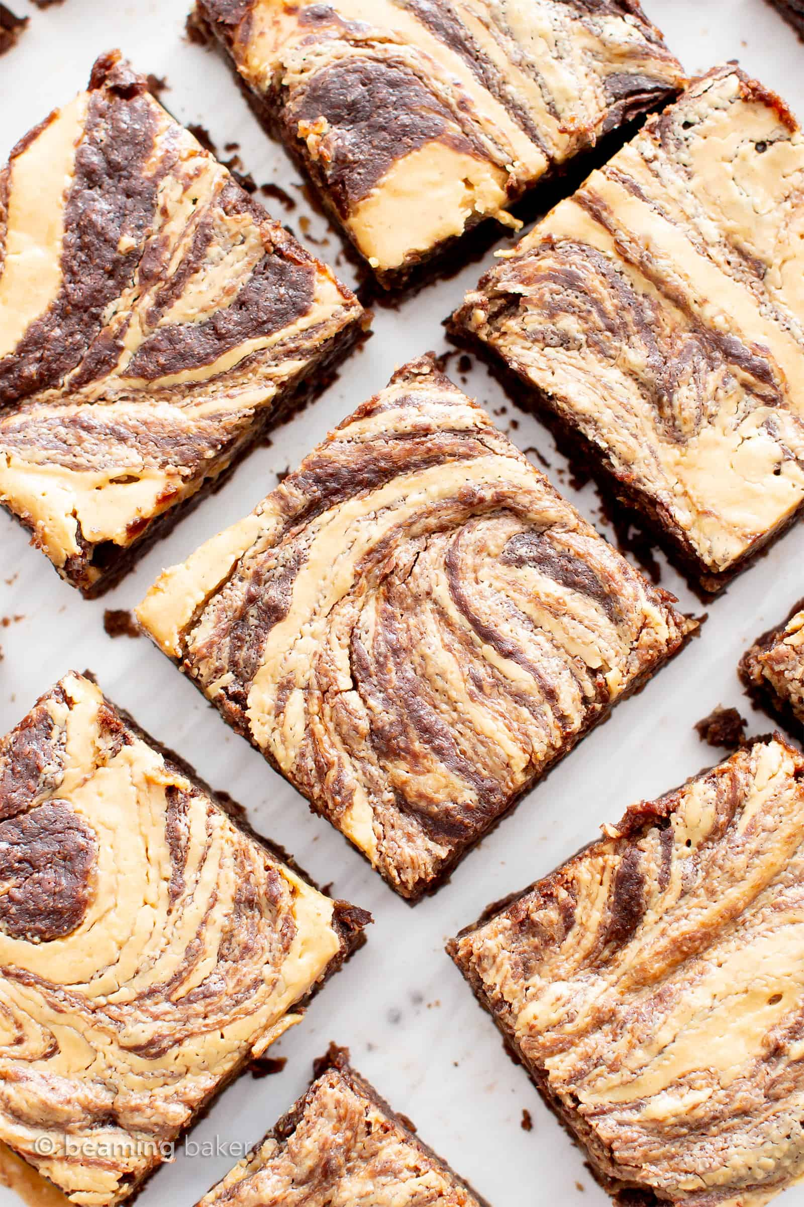 Fudgy Vegan Peanut Butter Swirl Brownies (Gluten Free): this vegan gluten free brownies recipe is made from scratch & easy! It's the fudgiest chocolate peanut butter swirl brownies ever—with thick ribbons of peanut butter and rich, moist brownie flavor! #Vegan #Brownies #GlutenFree #DairyFree #PeanutButter | Recipe at BeamingBaker.com