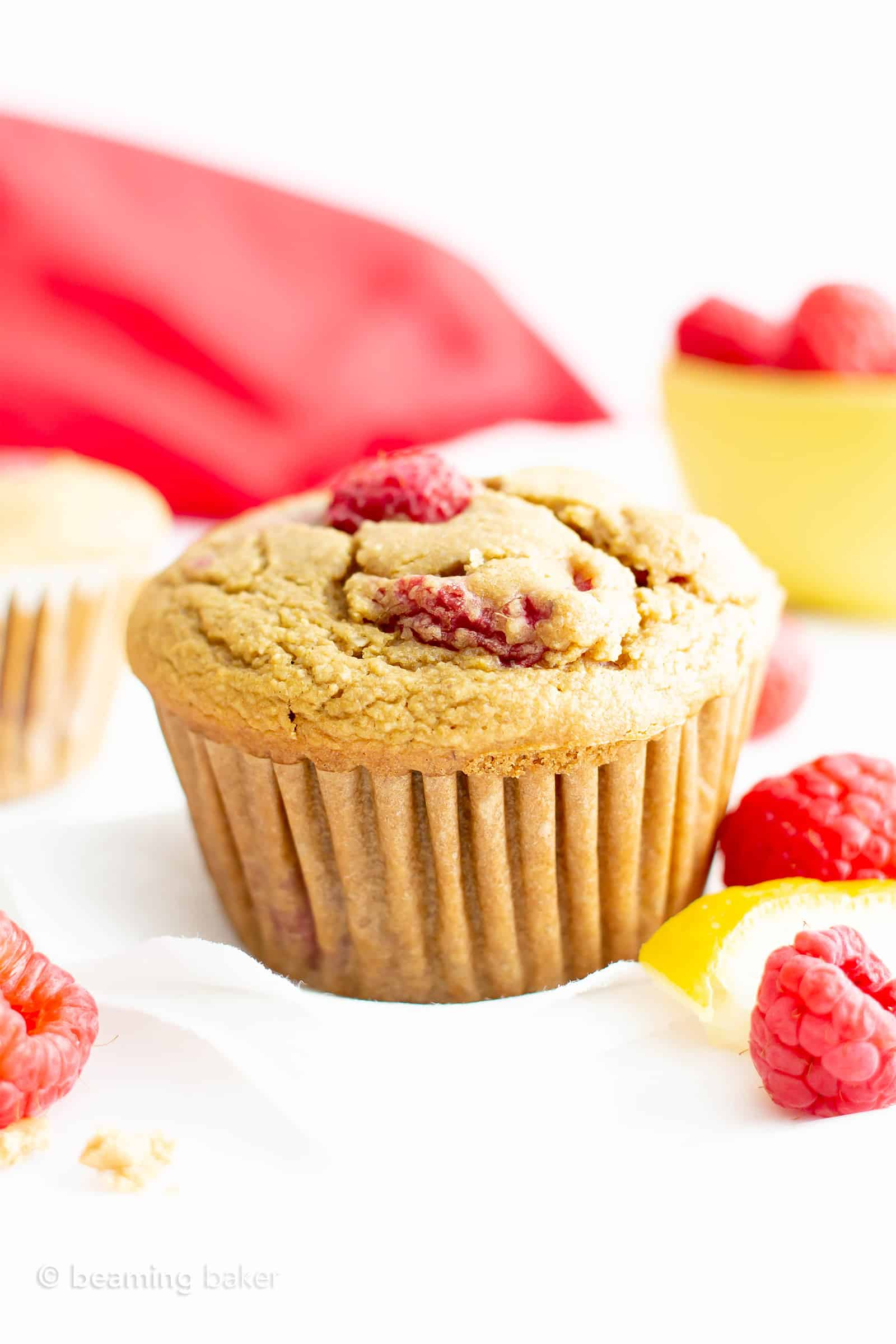 Healthy Lemon Raspberry Muffins Recipe (GF, V): this moist 'n easy lemon raspberry muffins recipe is gluten free & vegan! A healthy lemon raspberry muffins recipe that's bursting with raspberry flavor! #GlutenFree #Muffins #Healthy #Vegan #Lemon #Raspberry | Recipe at BeamingBaker.com
