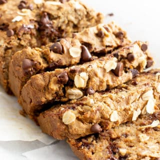 Super Moist Vegan Oatmeal Chocolate Chip Banana Bread (Gluten Free): a healthy banana bread recipe with oats & chocolate! It's the ultimate vegan oatmeal banana bread—moist, gluten free, dairy-free, made with GF oat flour! #Vegan #Bananas #GlutenFree #Oats #Chocolate | Recipe at BeamingBaker.com