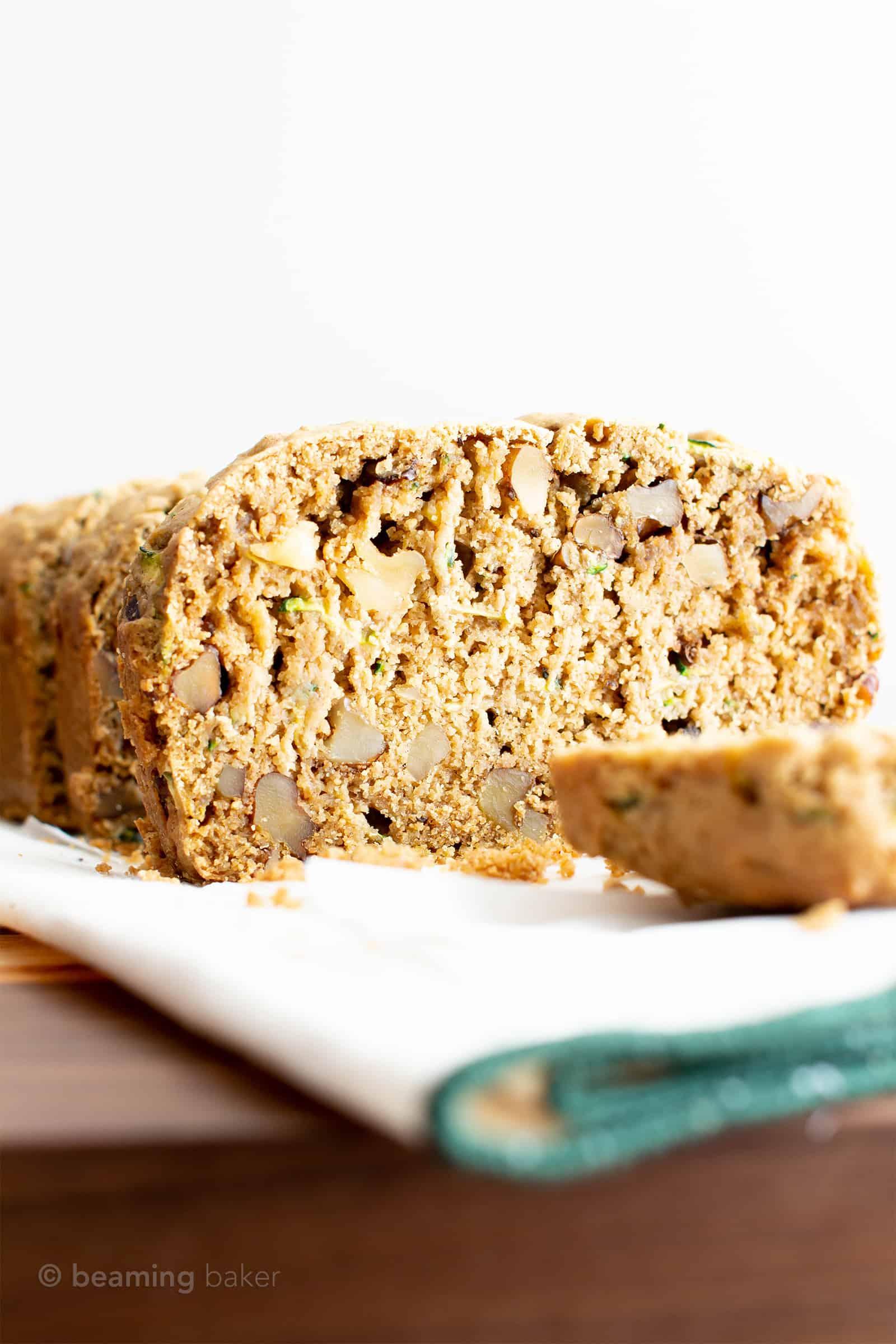 Irresistibly Moist Vegan Gluten Free Zucchini Bread Recipe (GF): this irresistible vegan zucchini bread is moist 'n buttery. The best vegan gluten free zucchini bread—easy recipe, perfect for summer! GF. #Vegan #GlutenFree #Zucchini #Bread | Recipe at BeamingBaker.com
