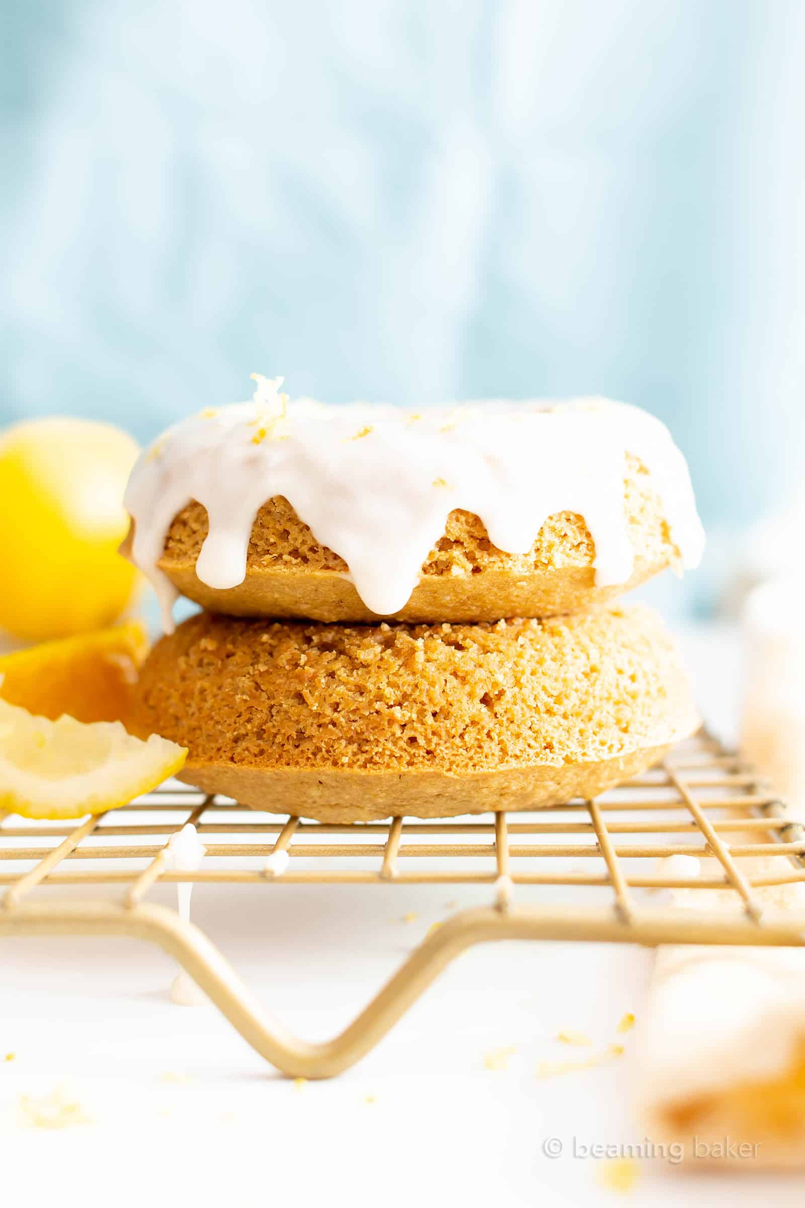 Vegan Soft Baked Lemon Donuts with Lemon Glaze (GF): this vegan gluten free donuts recipe yields soft and fluffy donuts with easy homemade lemon glaze! Healthy Doughnuts, Dairy-Free, Refined Sugar-Free. #Vegan #Donuts #Lemon #GlutenFree #DairyFree | Recipe at BeamingBaker.com