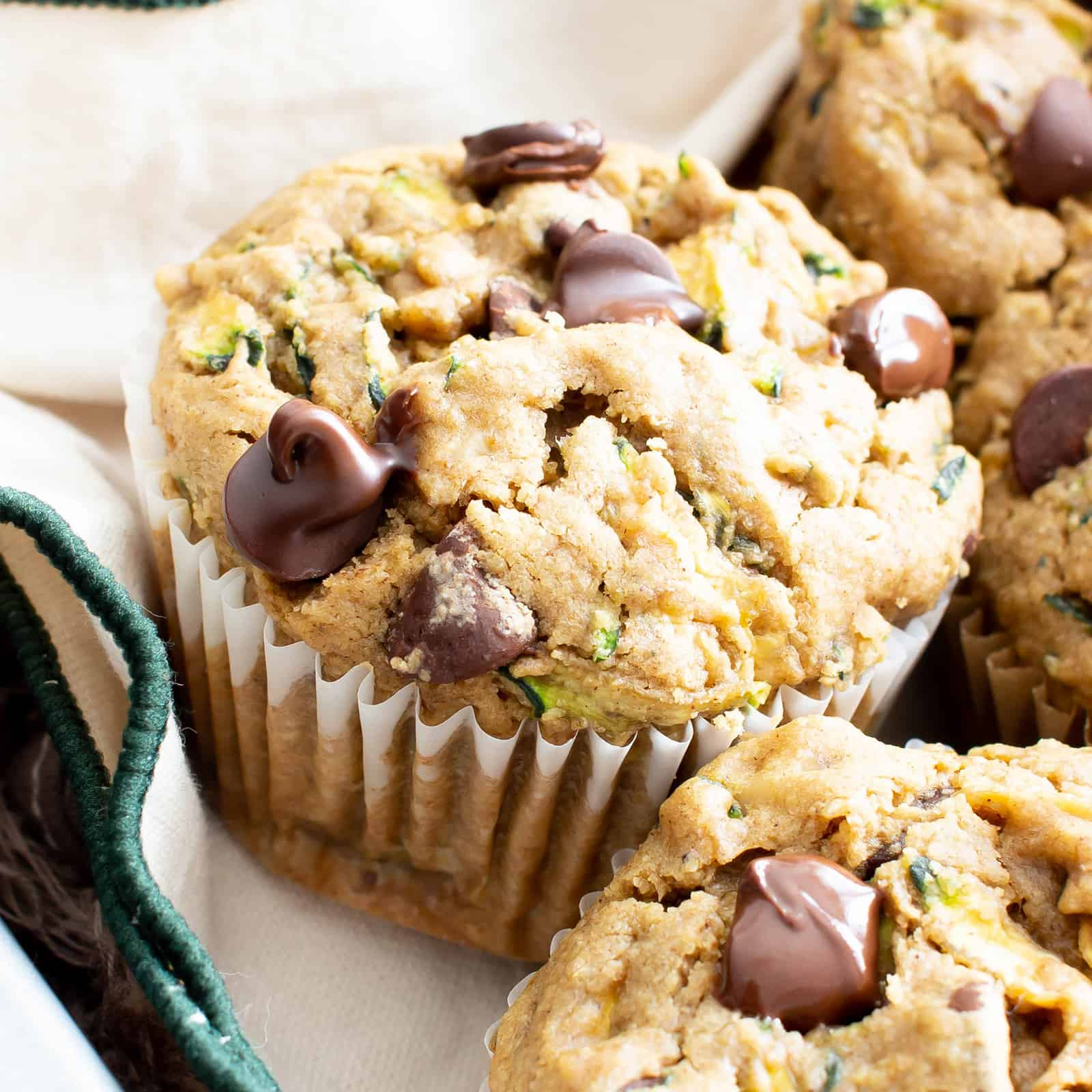 Healthy Moist Vegan Zucchini Muffins w/ Chocolate Chips (GF, V): this healthy zucchini muffins recipe is buttery, moist & fluffy! The best gluten free vegan zucchini muffins—egg free, easy & packed with chocolate! #Zucchini #Muffins #Vegan #GlutenFree #Healthy | Recipe at BeamingBaker.com