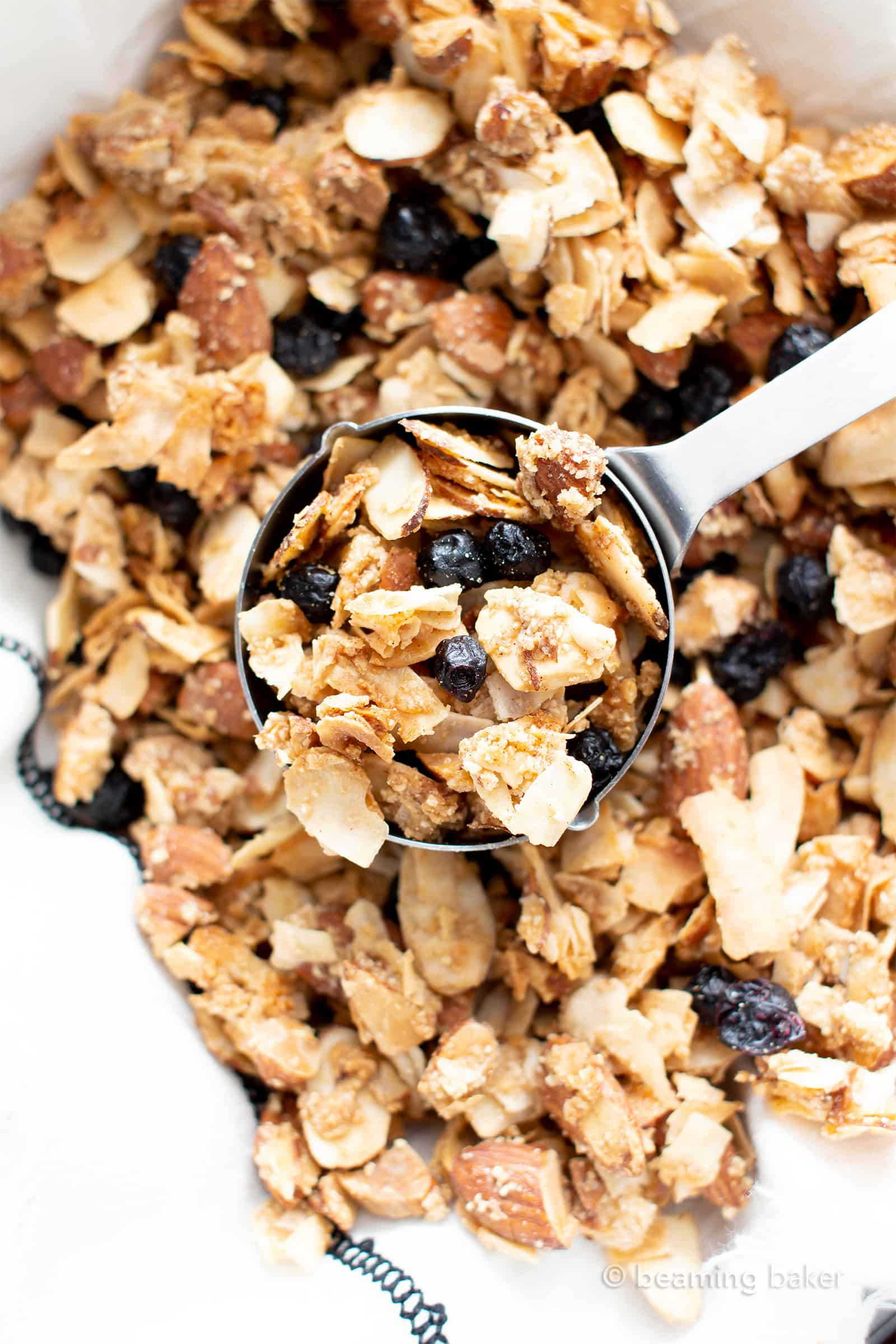 Paleo Vegan Granola (V, GF): a 5 ingredient recipe for sunny blueberry almond granola—crispy, crunchy clusters bursting with almonds & blueberries. The best healthy vegan breakfast recipe! #Vegan #Paleo #Granola #GlutenFree | Recipe at BeamingBaker.com