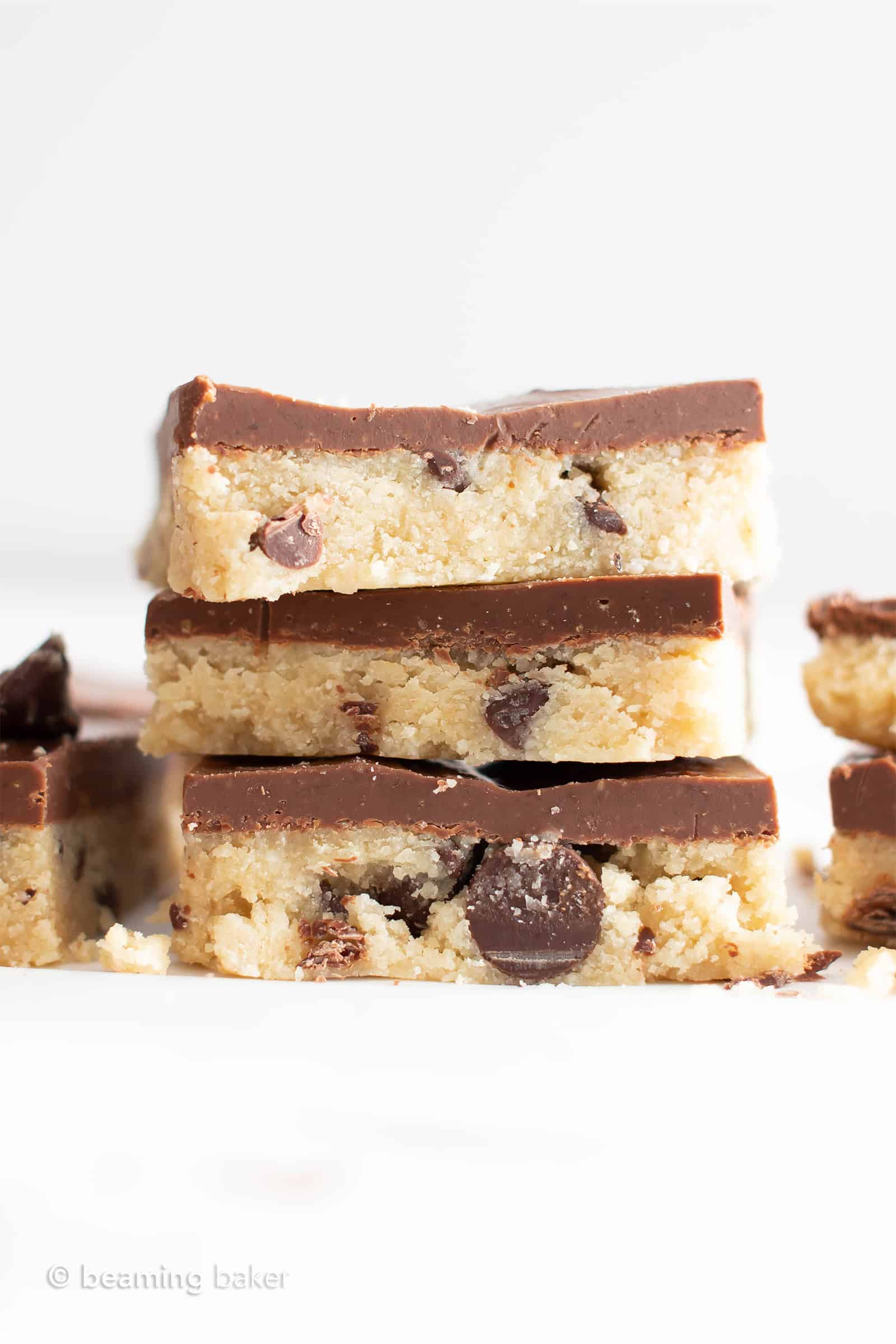 Paleo Cookie Dough Bars (GF): this almond flour cookie dough recipe is delicious & gluten free! Safe to eat & edible, no need to bake. Egg-Free, Vegan, Dairy-Free, Refined Sugar-Free. #Vegan #Paleo #CookieDough #Chocolate | Recipe at BeamingBaker.com