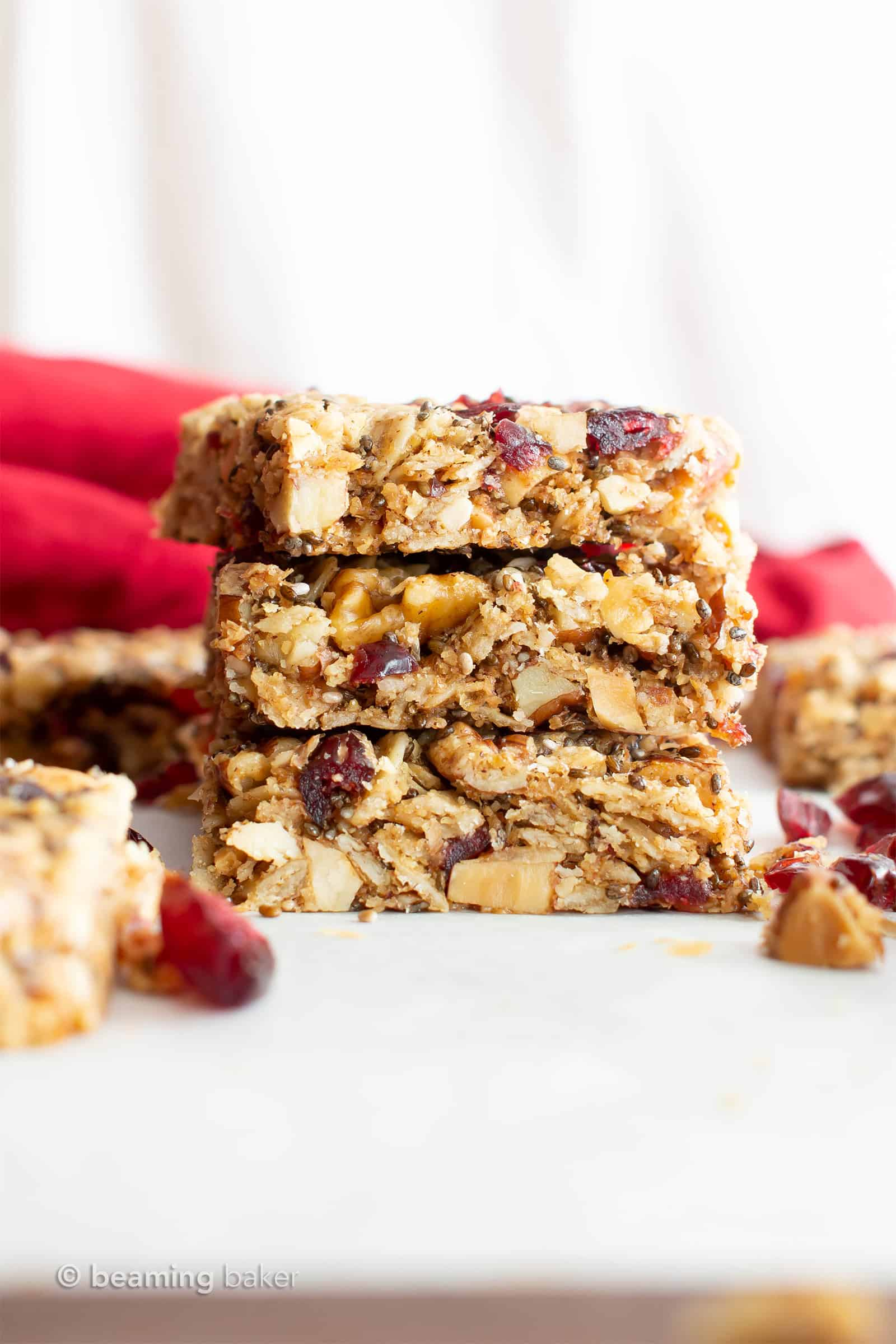 Cranberry Chia Gluten Free Vegan Snack Bars: this healthy vegan snack bars recipe yields chewy & satisfying bars! The best vegan snack bars recipe—packed with chia & flax to keep you full! #Snacks #Bars #GlutenFree #Vegan #Chia | Recipe at BeamingBaker.com