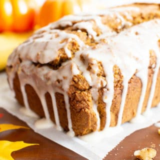 Glazed Vegan Gluten Free Pumpkin Bread Recipe (GF): easy & moist pumpkin bread made in just 1 bowl! The BEST vegan pumpkin bread recipe—flavorful, full of warm spices, made with healthy ingredients and topped with a sweet glaze. #Vegan #Pumpkin #GlutenFree #Bread | Recipe at BeamingBaker.com
