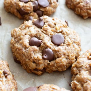Vegan Oatmeal Chocolate Chip Cookies (GF): my FAVORITE Vegan oatmeal chocolate chip cookies have crisp edges, chewy centers and are chockfull of chocolate! This vegan Gluten Free oatmeal chocolate chip cookies recipe is Dairy-Free & made from Plant-Based, Whole Ingredients. #Vegan #OatmealCookies #ChocolateChip #GlutenFree | Recipe at BeamingBaker.com