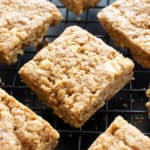 Vegan Oatmeal Peanut Butter Cookie Bars (GF): the best salty & sweet oatmeal cookie bars, with chewy, crispy edges, chopped peanuts, and bursting with Peanut Butter flavor! Gluten-Free, Dairy-Free. #PeanutButter #Oatmeal #Vegan #GlutenFree | Recipe at BeamingBaker.com