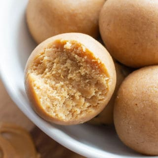 Peanut Butter Keto Energy Balls Recipe: just 3 ingredients for easy keto energy bites bursting with peanut butter flavor! Quick breakfast, protein-packed, Vegan, Gluten Free & Healthy. #Keto #PeanutButter #Healthy #LowCarb | Recipe at BeamingBaker.com