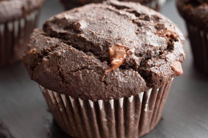 Paleo Chocolate Muffins: moist Gluten Free chocolate muffins with almond flour, tons of chocolate & crispy tops! Easy, Grain-Free, Vegan, Healthy ingredients. #Paleo #Muffins #GlutenFree #Chocolate | Recipe at BeamingBaker.com
