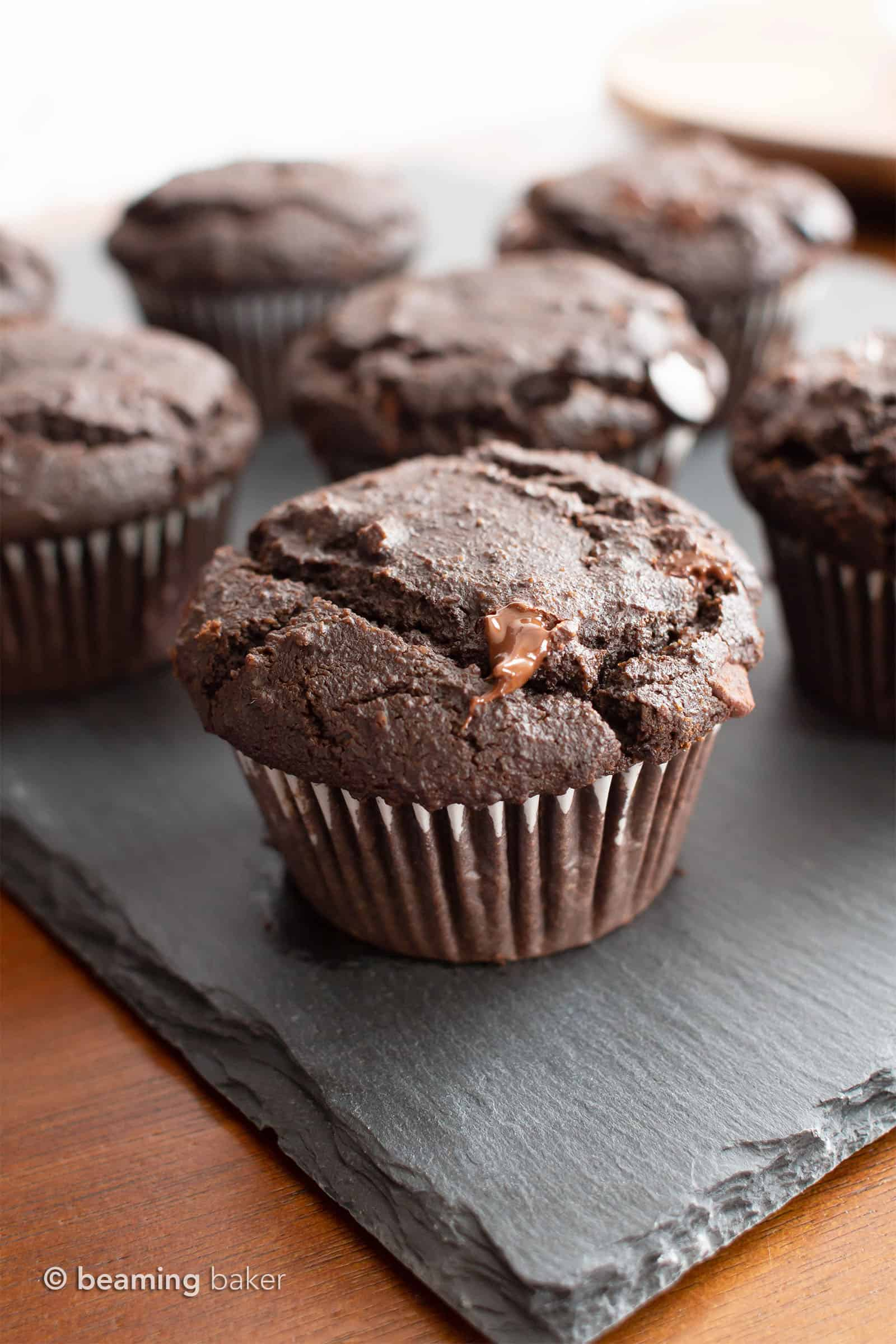 Paleo Chocolate Muffins: moist Gluten Free chocolate muffins with almond flour, tons of chocolate & crispy tops! Easy, Grain-Free, Vegan, Healthy ingredients. #Paleo #Muffins #GlutenFree #Chocolate | Recipe at BeamingBaker.com