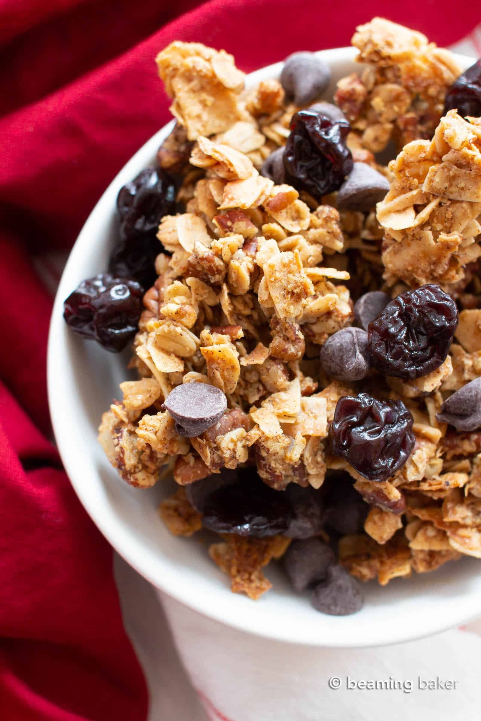 Healthy Granola Recipe with Cherries & Chocolate: the best EASY healthy granola recipe with BIG chunky clusters, packed full of nutty crunch, satisfying chewy oats, tart & sweet cherries with chocolate! #Granola #Healthy #Snacks #Vegan | Recipe at BeamingBaker.com