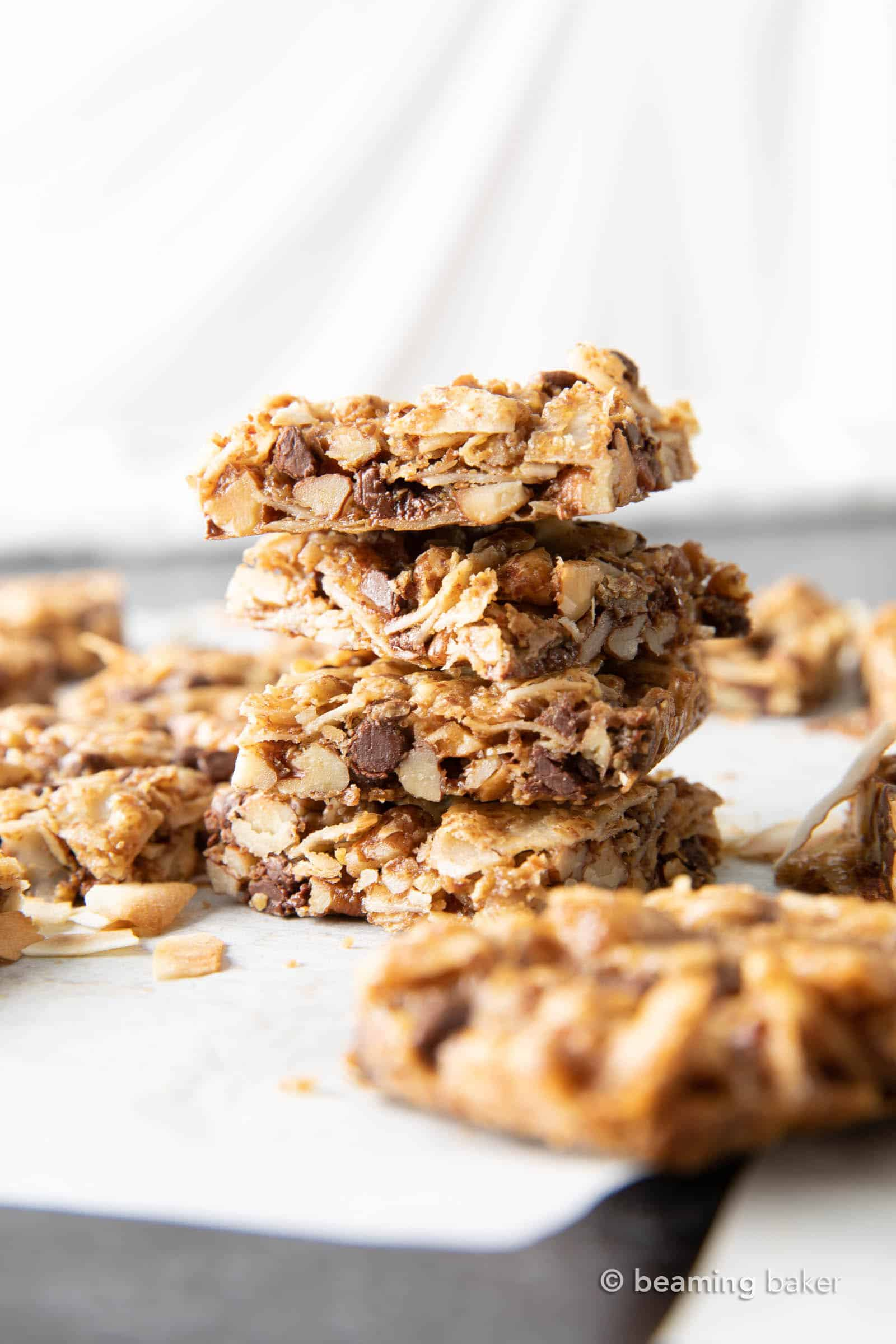 Coconut Granola Bars (Paleo): chewy & healthy homemade granola bars bursting with coconut & nuts! Deliciously healthy granola bars—Paleo, Grain-Free, Vegan, Gluten Free. #GranolaBars #Paleo #Healthy #Vegan | Recipe at BeamingBaker.com
