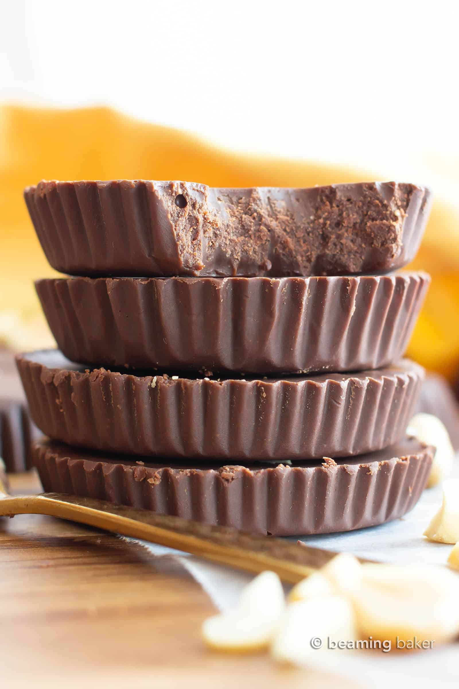 Keto Chocolate Peanut Butter Fudge Cups: this 5 Minute chocolate peanut butter fudge recipe is so easy! Just 2 ingredients for yummy cups of creamy, rich Low Carb fudge! #Keto #LowCarb #Vegan #Fudge #PeanutButter | Recipe at BeamingBaker.com