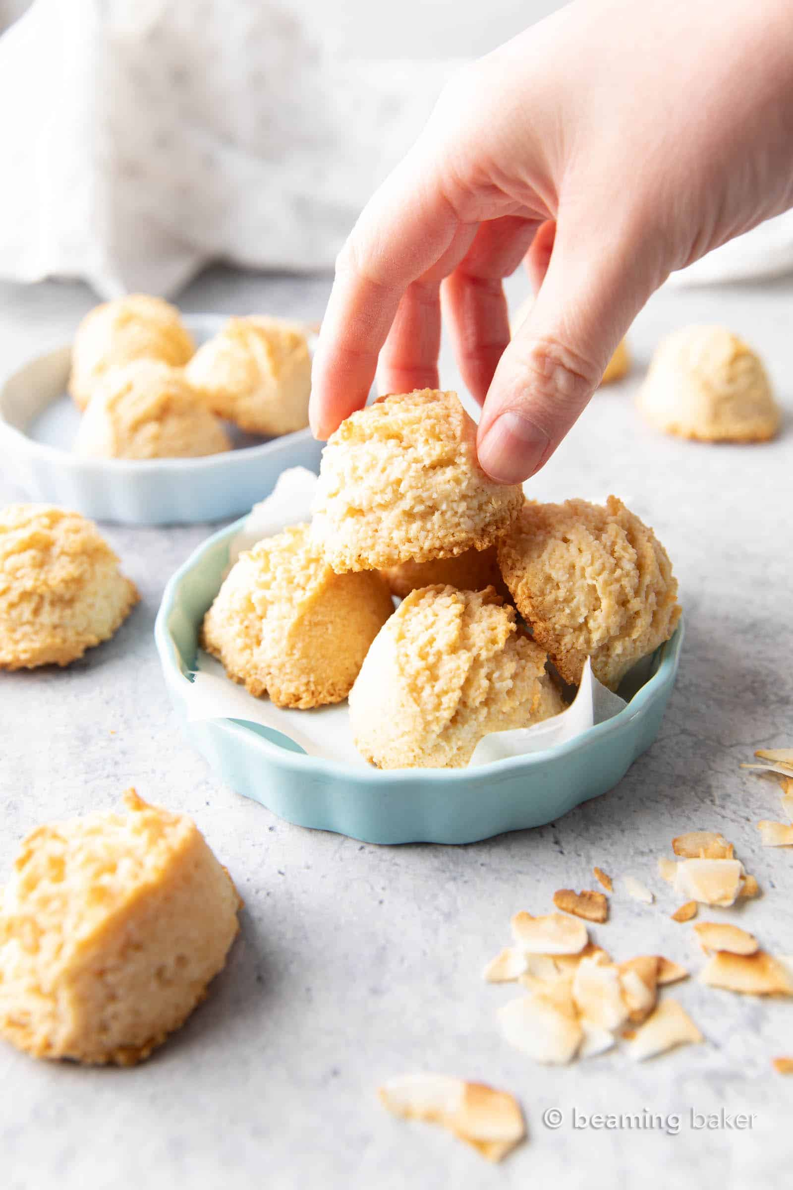 Gluten Free Coconut Macaroons Recipe: this easy gluten free macaroons recipe yields soft & chewy coconut cookies with a crispy exterior! Vegan, Paleo, Dairy-Free, Egg-Free. #Coconut #Macaroons #GlutenFree #Cookies #Easter | Recipe at BeamingBaker.com