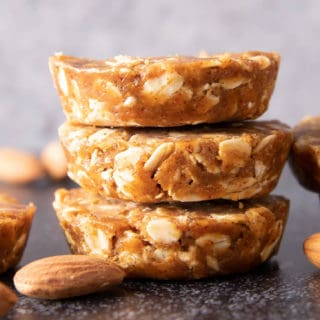 Easy Oatmeal Cups with Almond Butter: this 3 ingredient No Bake oatmeal cups recipe yields soft & chewy oatmeal cups—the perfect Quick 'n Easy snack on-the-go! Vegan, Gluten Free. #PeanutButter #Oatmeal #NoBake #HealthySnacks | Recipe at BeamingBaker.com
