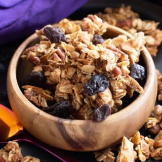 Oatmeal Raisin Vegan Granola Recipe: super CHUNKY, big cluster homemade vegan granola with juicy raisins and fiber-rich oats! Gluten Free, Healthy, Dairy-Free. #Granola #Healthy #GlutenFree #Vegan | Recipe at BeamingBaker.com