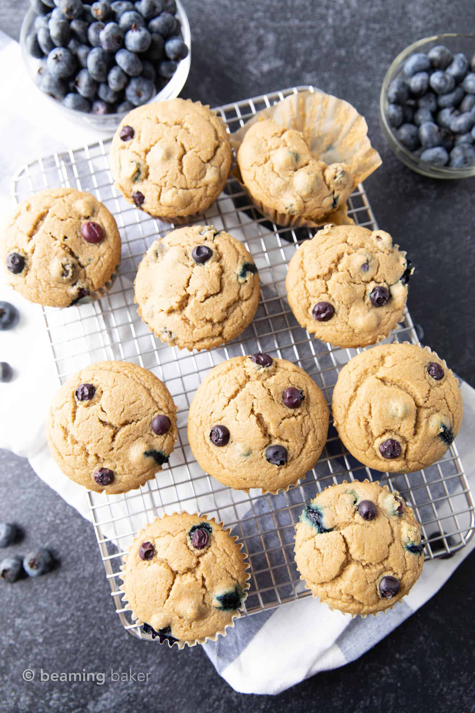 Easy Vegan Blueberry Muffins Recipe: this soft 'n moist vegan blueberry muffins recipe yields fluffy, bright blueberry muffins. Gluten Free, Dairy-Free. #Vegan #Blueberry #Muffins #GlutenFree | Recipe at BeamingBaker.com
