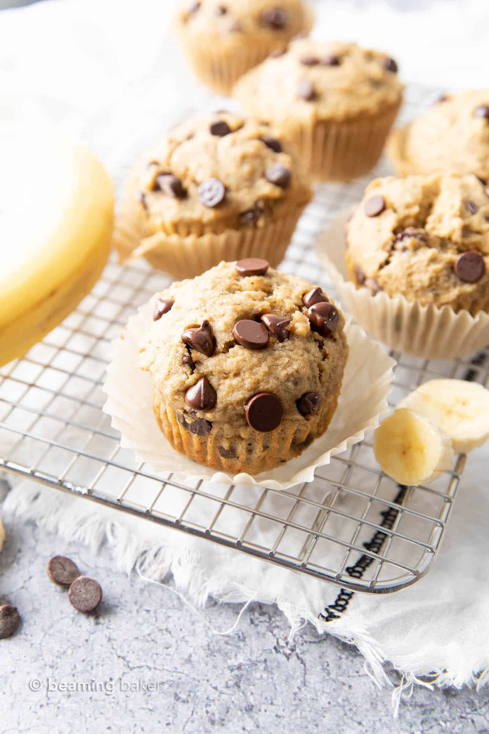 Healthy Banana Chocolate Chip Muffins: soft & moist banana bread muffins with sky-high, crispy tops, melty chocolate chips & BIG banana flavor. Whole ingredients, Plant-Based. #Muffins #Bananas #Chocolate #Healthy | Recipe at BeamingBaker.com