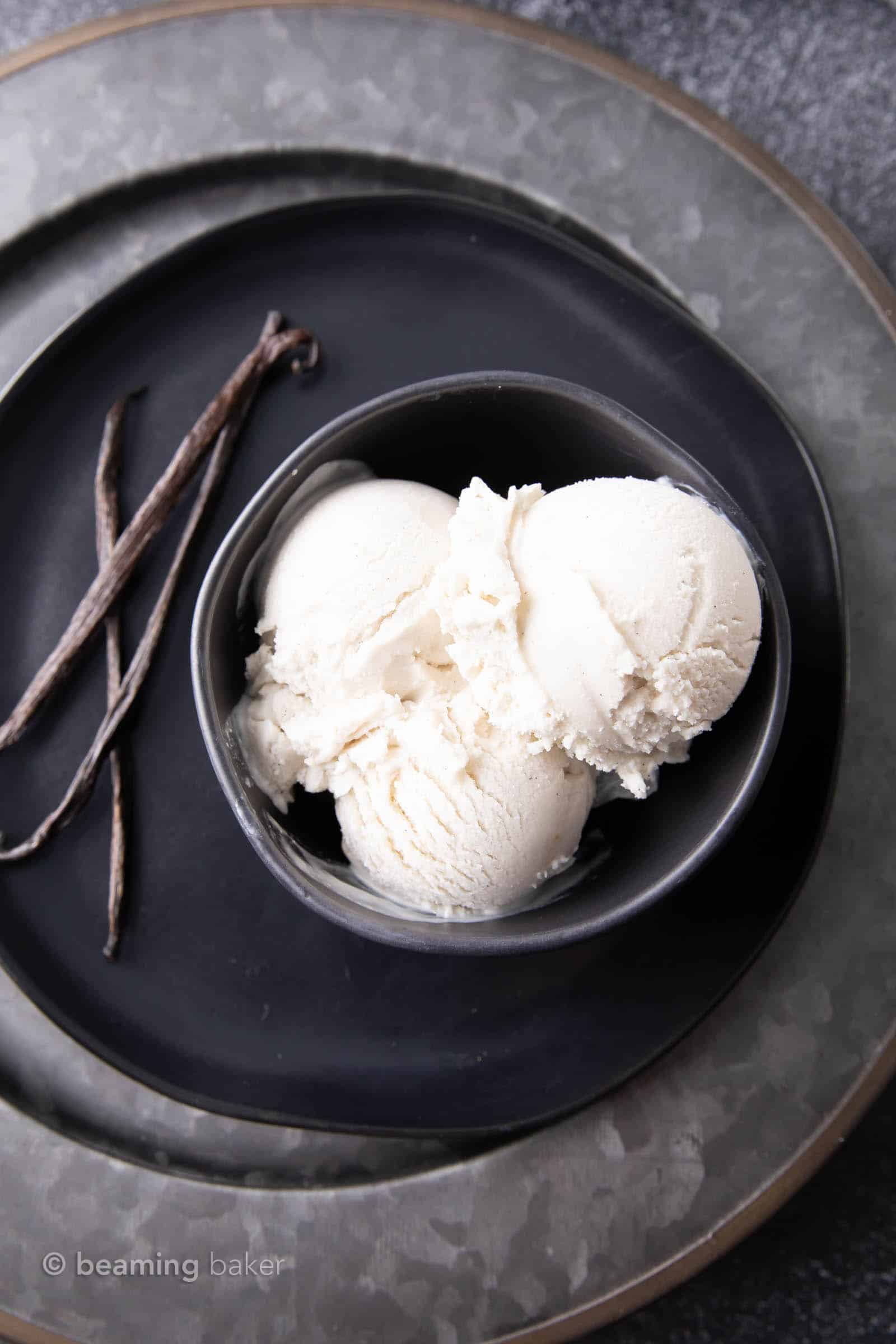 Vegan Vanilla Ice Cream Recipe: this homemade vegan ice cream recipe is EASY, rich 'n creamy. The best vegan vanilla ice cream made with simple ingredients & an ice cream maker! Dairy-Free. #Vegan #IceCream #VanillaIceCream #VeganIceCream | Recipe at BeamingBaker.com