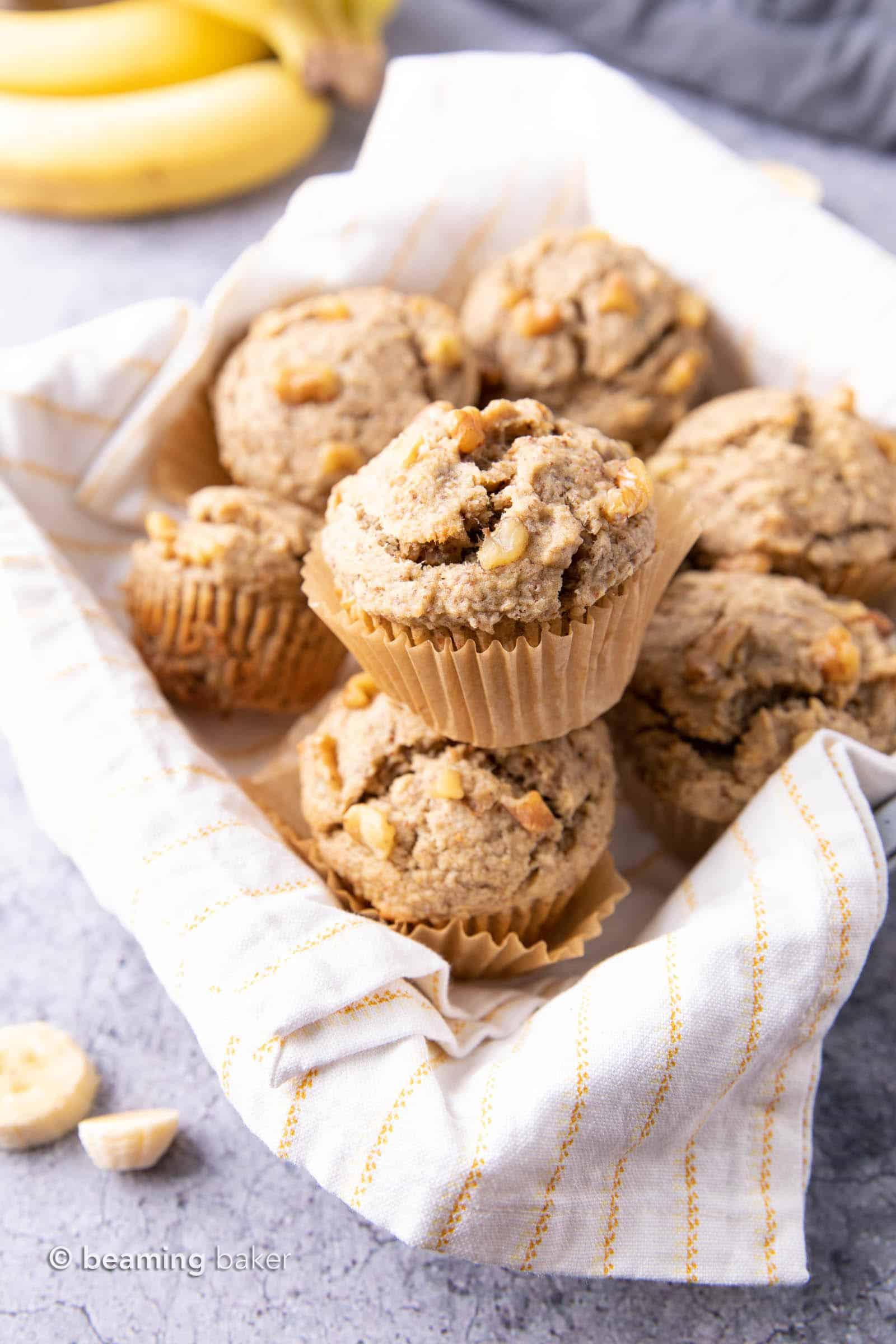 Vegan Banana Muffins Recipe: soft 'n moist vegan banana bread muffins with a satisfying texture and big banana flavor! #Vegan #Banana #Muffins #DairyFree | Recipe at BeamingBaker.com