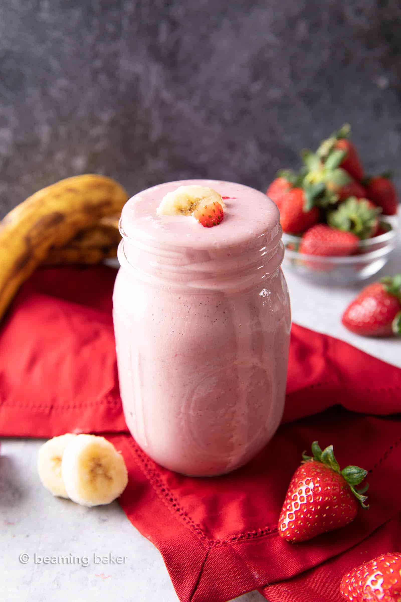 Strawberry Banana Smoothie Recipe: learn how to make a strawberry banana smoothie with 3 ingredients! Smooth, creamy and refreshing! Healthy, Easy to Make, Simple Ingredients. #Strawberry #Smoothie #Banana #Recipe | Recipe at BeamingBaker.com