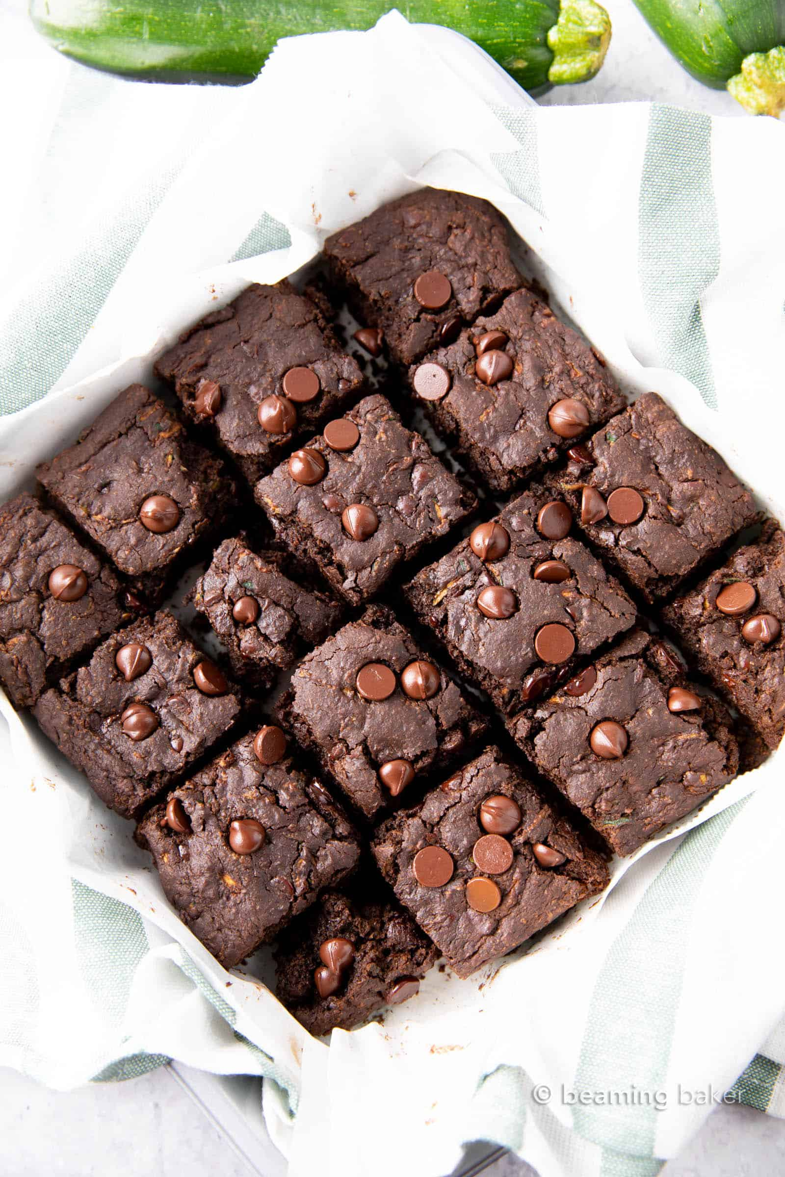 Healthy Zucchini Brownies (Vegan, GF): this chocolate zucchini brownies recipe yields moist, tender cakey brownies with rich chocolate flavor & a lightly fudgy texture. Vegan, Healthy. #Zucchini #ZucchiniBrownies #HealthyDesserts #Healthy #Vegan | Recipe at BeamingBaker.com