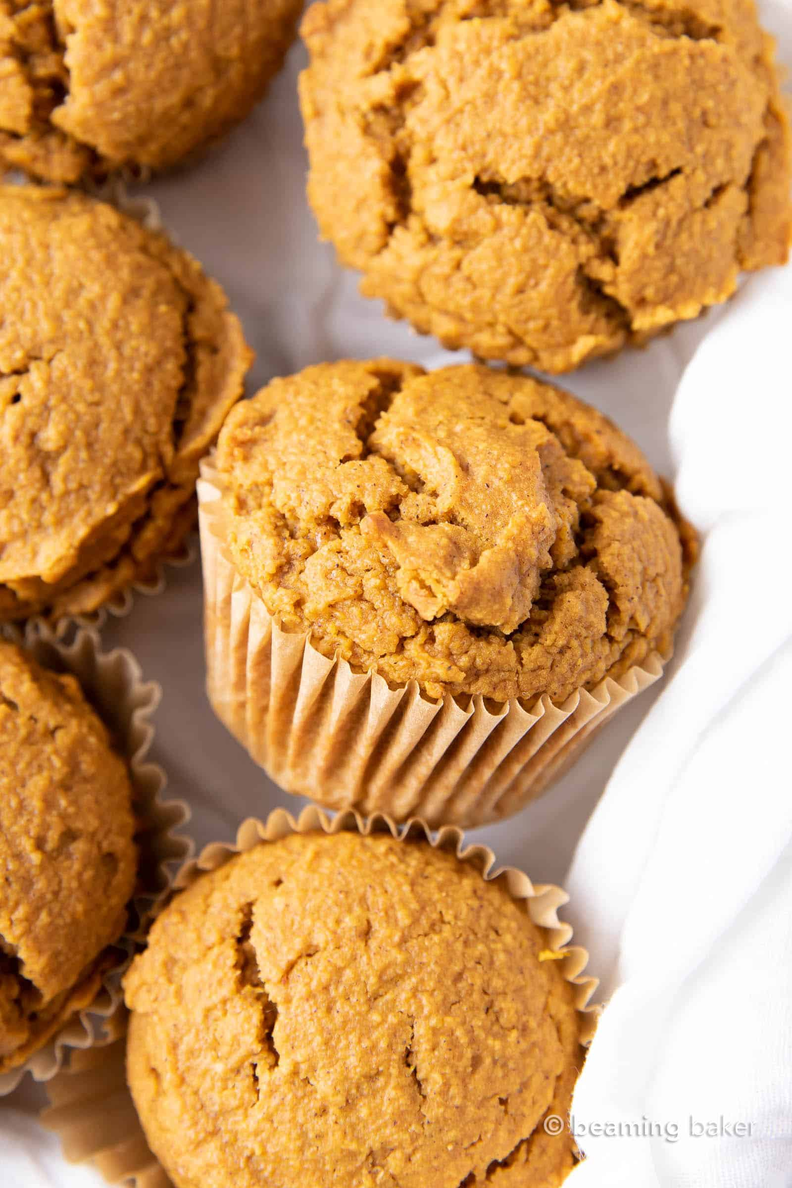 Vegan Pumpkin Muffins: this vegan pumpkin muffin recipe is easy & eggless! The best vegan pumpkin muffins – moist, soft & tender crumb, perfectly spiced. #Vegan #Pumpkin #Muffins #Fall | Recipe at BeamingBaker.com