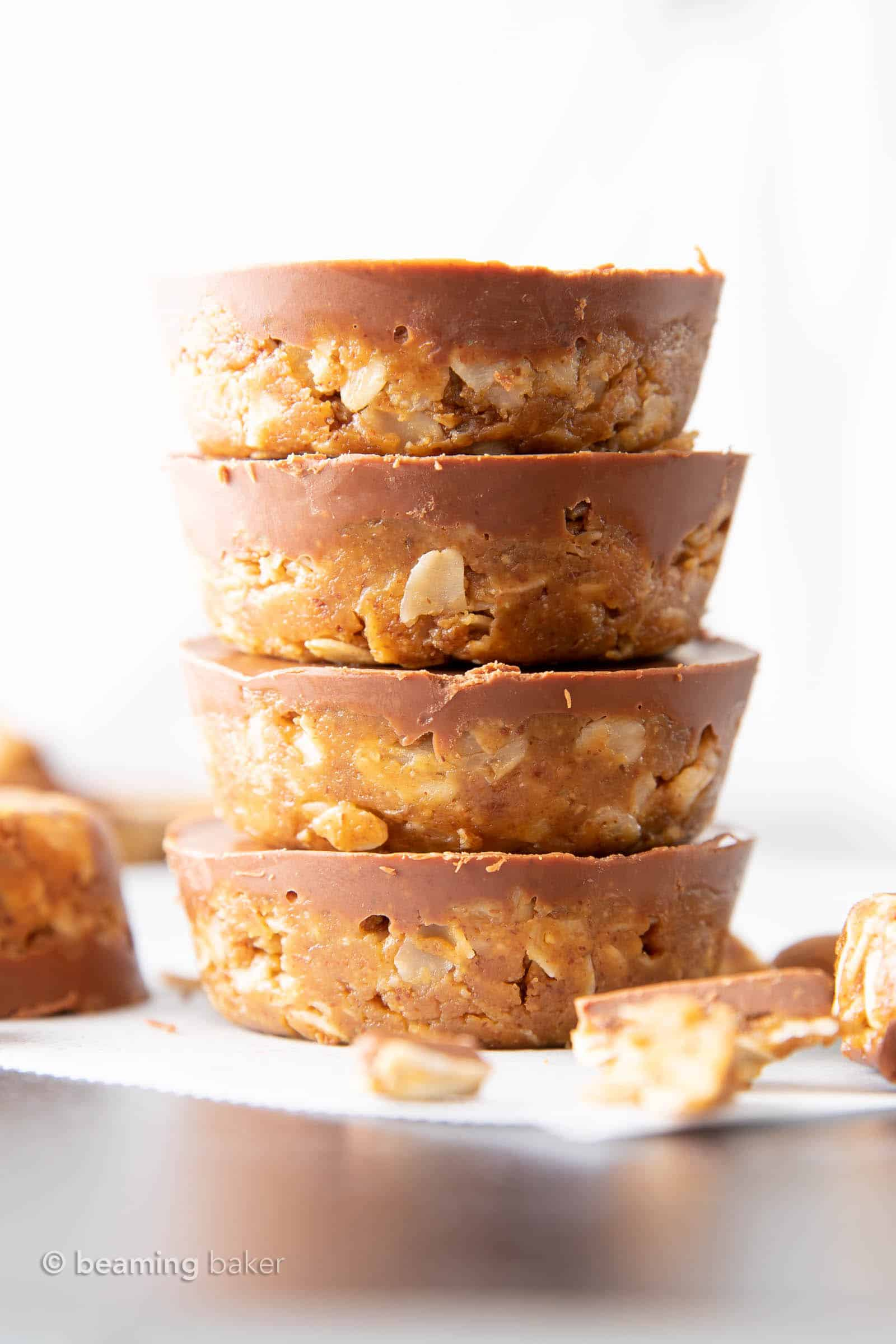 Chocolate Almond Butter Oatmeal Cups: an easy 4 ingredient recipe for no bake oatmeal cups with almond butter & chocolate topping! A quick & easy healthy snack that's delicious! #Chocolate #AlmondButter #Snacks #Oatmeal | Recipe at BeamingBaker.com