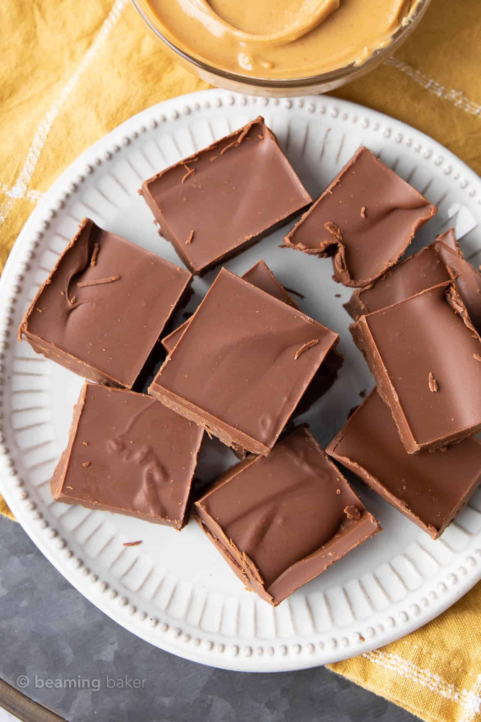 Chocolate Peanut Butter Vegan Fudge: this 2 ingredient EASY vegan fudge recipe yields thick squares of decadent, rich fudge that tastes like peanut butter cups! #Vegan #Chocolate #PeanutButter #Fudge | Recipe at BeamingBaker.com