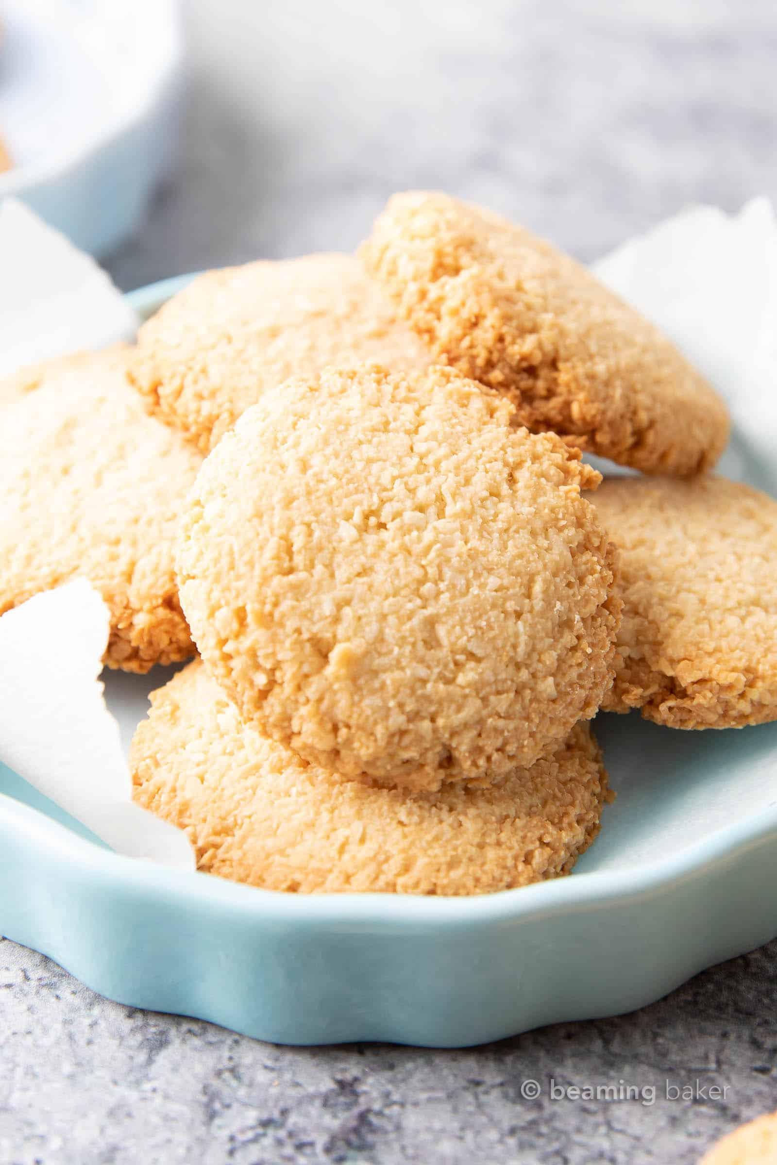 Vegan Coconut Cookies: an easy 4 ingredient recipe for crunchy, crispy vegan cookies packed with three kinds of coconut! #Vegan #Cookies #Coconut #VeganCookies   Recipe at BeamingBaker.com