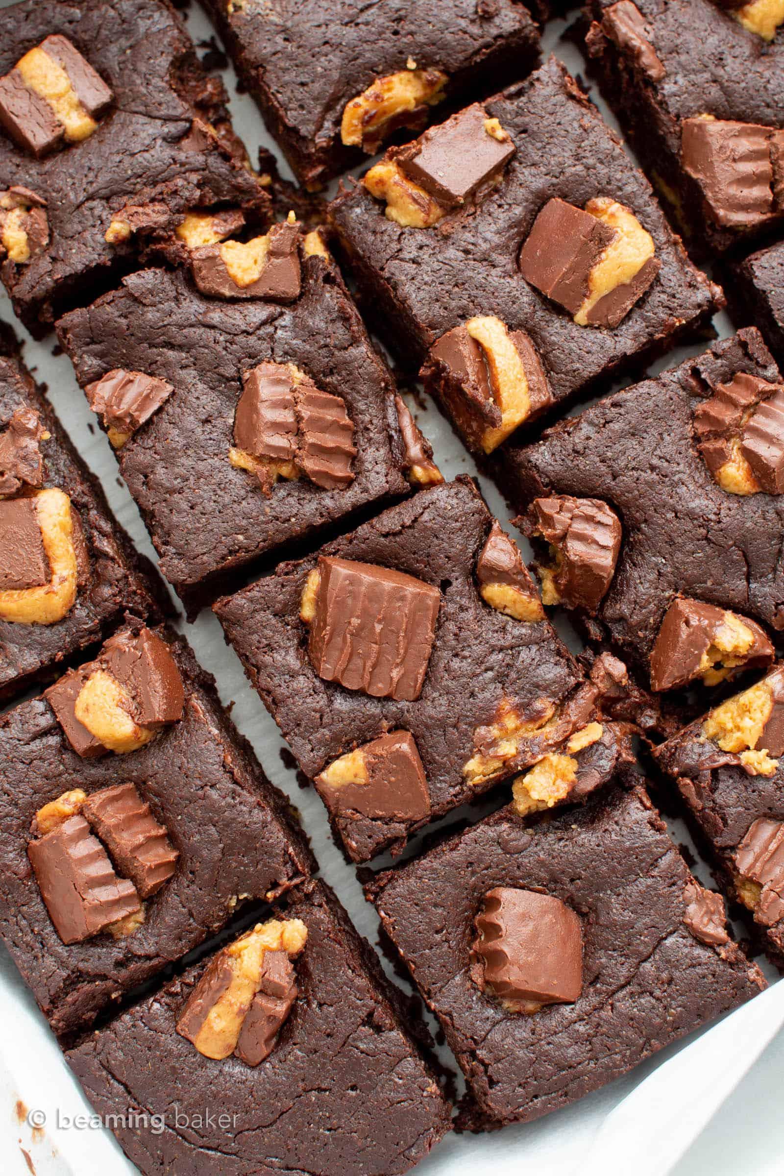 Vegan Peanut Butter Cup Brownies: moist 'n fudgy peanut butter cup brownies! These vegan peanut butter brownies are bursting with chocolate & peanut butter cups. #PeanutButter #Brownies #VeganBrownies #Vegan | Recipe at BeamingBaker.com
