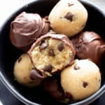 Healthy Cookie Dough Truffles: the ultimate healthy edible cookie dough recipe yields rich 'n satisfying healthy cookie dough bites wrapped in velvety chocolate. #Healthy #CookieDough #Edible | Recipe at BeamingBaker.com