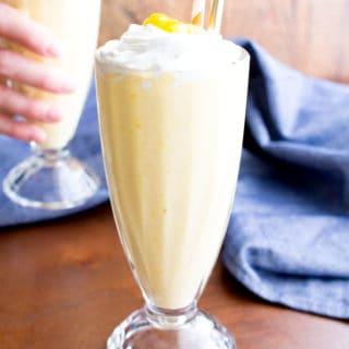 Mango Vegan Milkshake: this 3 ingredient vegan milkshake recipe is thick 'n creamy with delicious mango coconut flavor. The easiest homemade vegan milkshake! #Vegan #Milkshake #Mango | Recipe at BeamingBaker.com