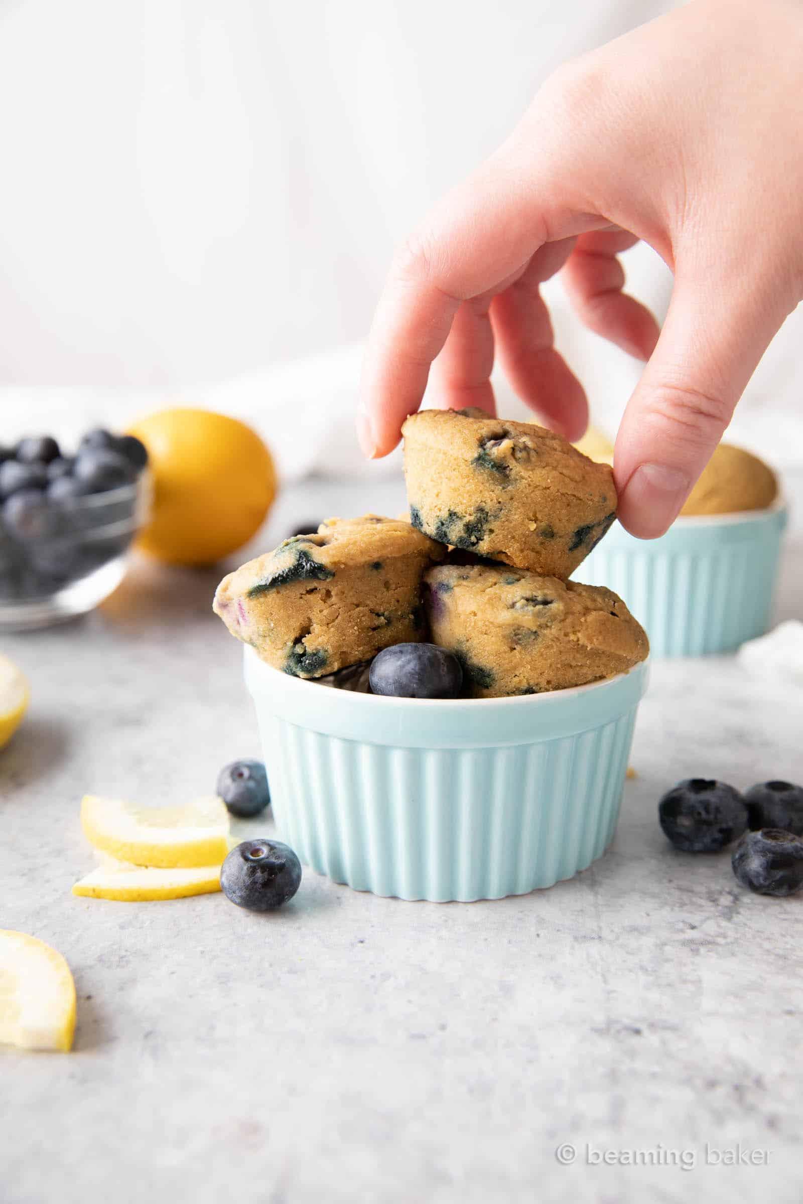 Mini Vegan Lemon Blueberry Muffins: super cute, mini-sized moist vegan lemon blueberry muffins. Bright blueberry & fresh lemon flavor packed into tiny vegan muffins! #Vegan #Lemon #Blueberry #Muffins   Recipe at BeamingBaker.com