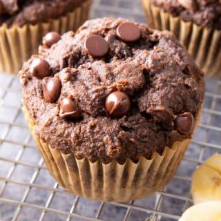 Healthy Banana Chocolate Chocolate Chip Muffins: tender & moist rich chocolate banana muffins. The best healthy chocolate banana muffins—fluffy & fudgy, deep chocolate brownie flavor. SO GOOD! #Healthy #Chocolate #Banana #Muffins | Recipe at BeamingBaker.com