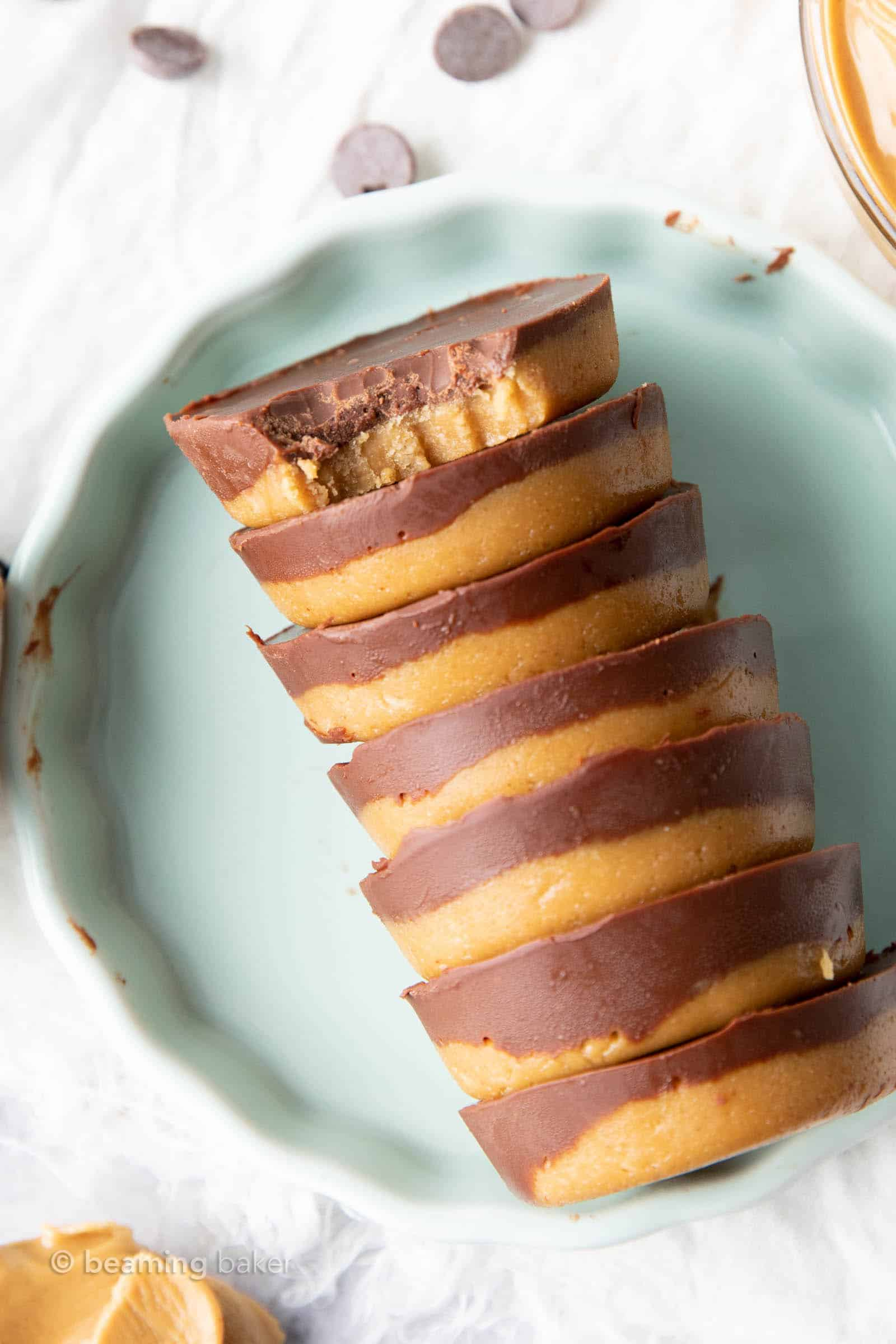 keto peanut butter cups with a bowl of peanut butter